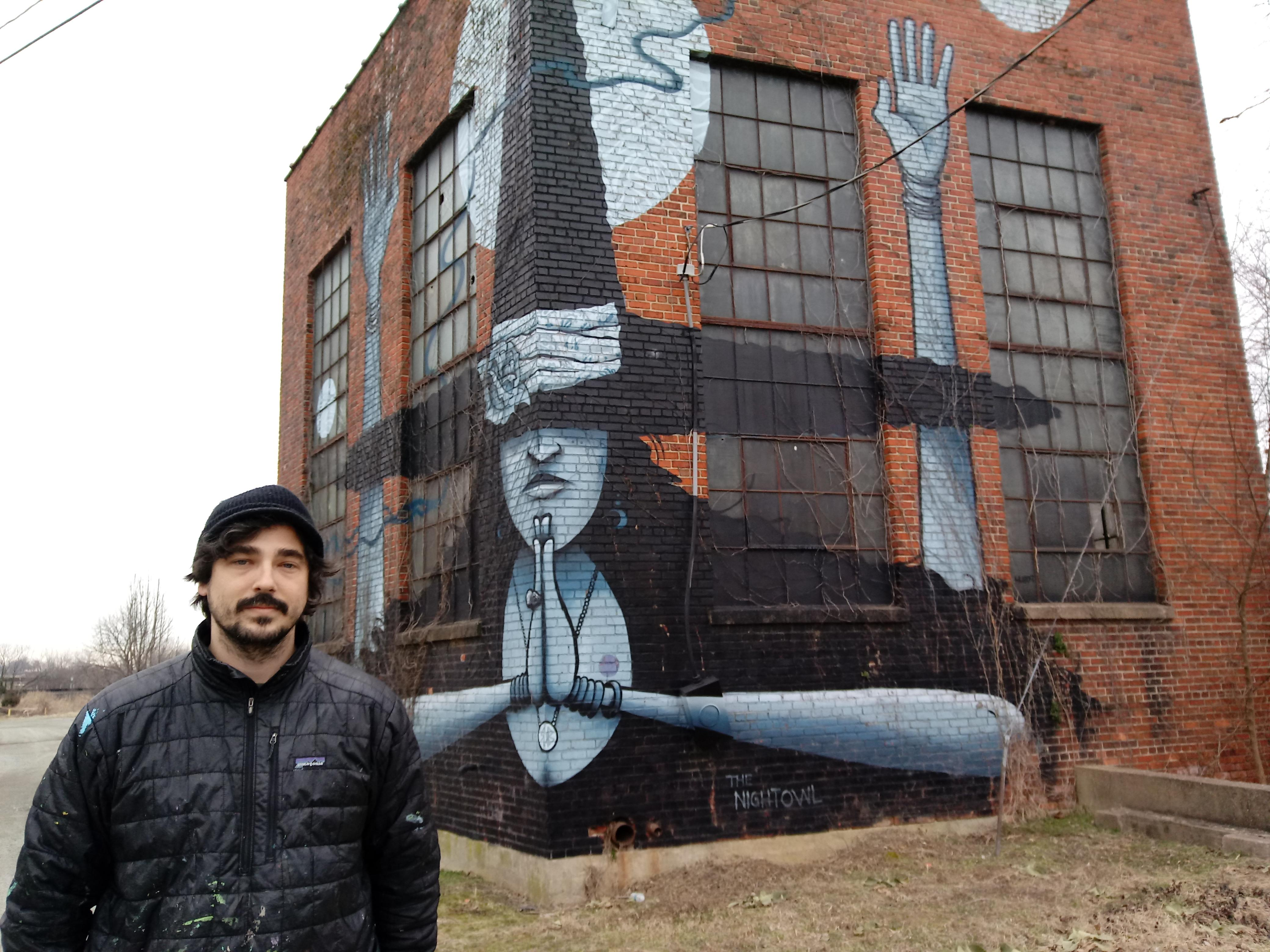 Muralist Mickael Broth with one of his creations.{&nbsp;}(Image: Michael Solender)<br>