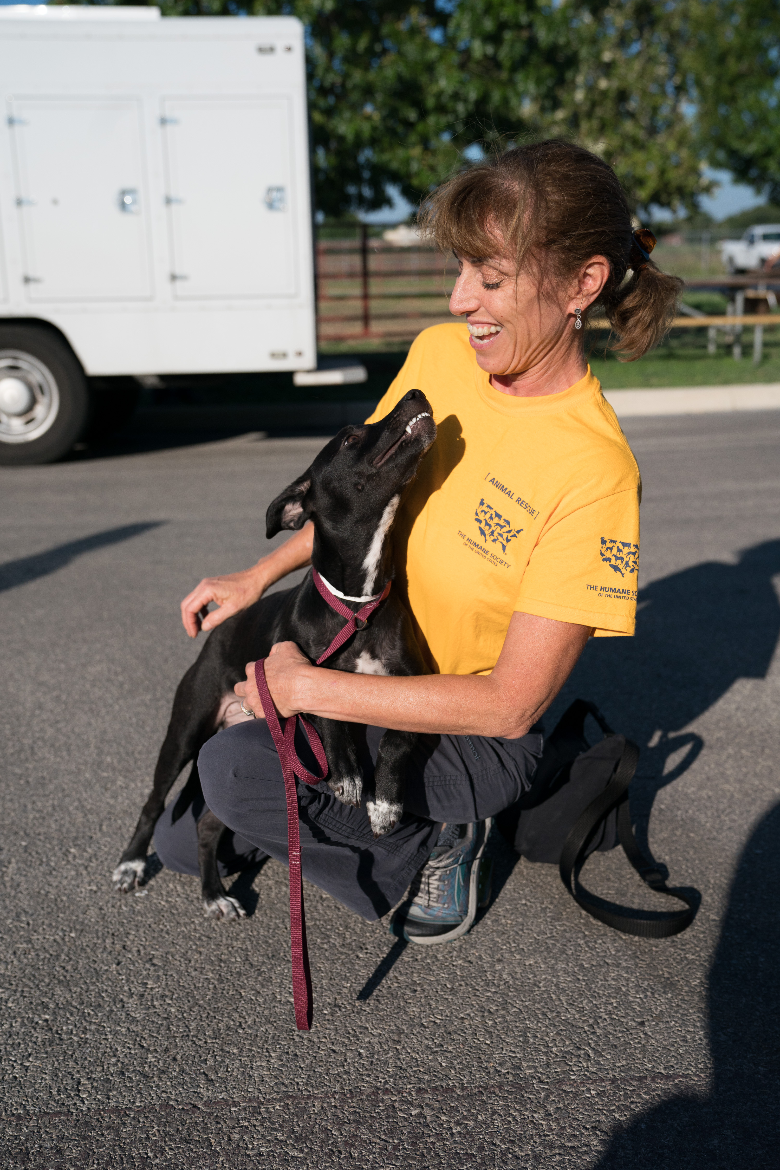 Humane Society of the United States District Leader Shana Ellison interacts with a puppy during The HSUS San Antonio Transport, Tuesday, Aug. 29, 2017, in San Antonio. Approximately one hundred dogs are being transported by Wings of Rescue to the east coast for adoption. (Darren Abate/AP Images for The Humane Society of the United States)