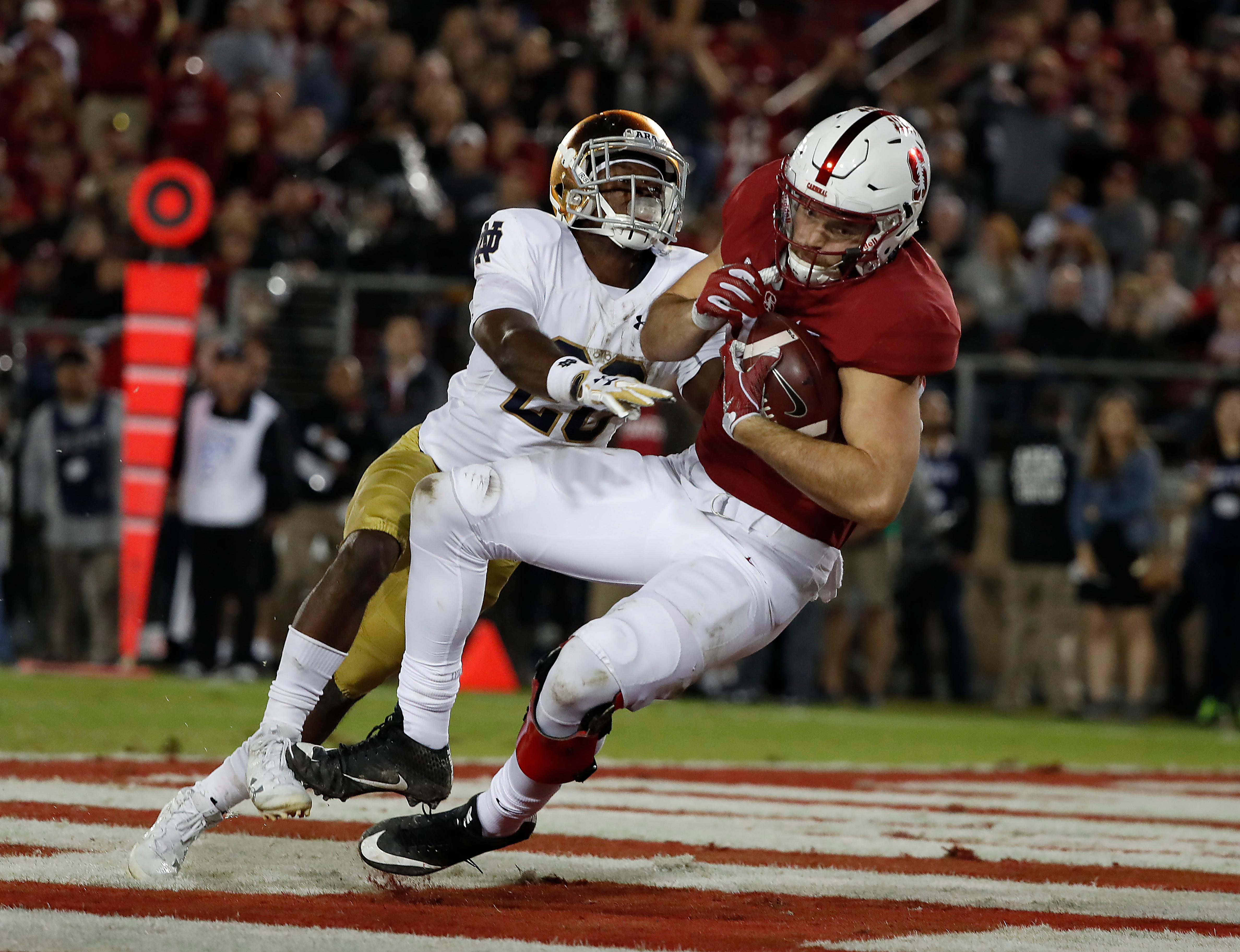 FILE - In this Nov. 25, 2017, file photo, Stanford tight end Kaden Smith (82) catches a touchdown pass in front of Notre Dame cornerback Shaun Crawford (20) during the second half of an NCAA college football game, in Stanford, Calif. Smith was selected to the AP All-Conference Pac-12 team announced Thursday, Dec. 7, 2017. (AP Photo/Tony Avelar, File)