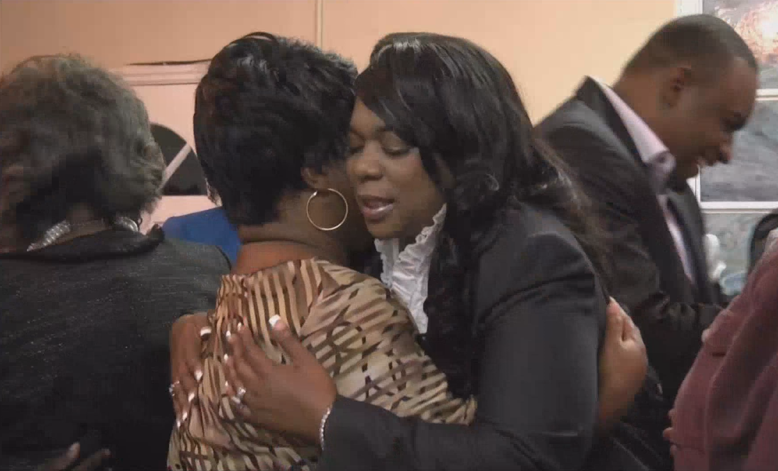 Lady Kimara Weeks, right, hugs the mother of a shooting victim.{&amp;nbsp;}<p></p>