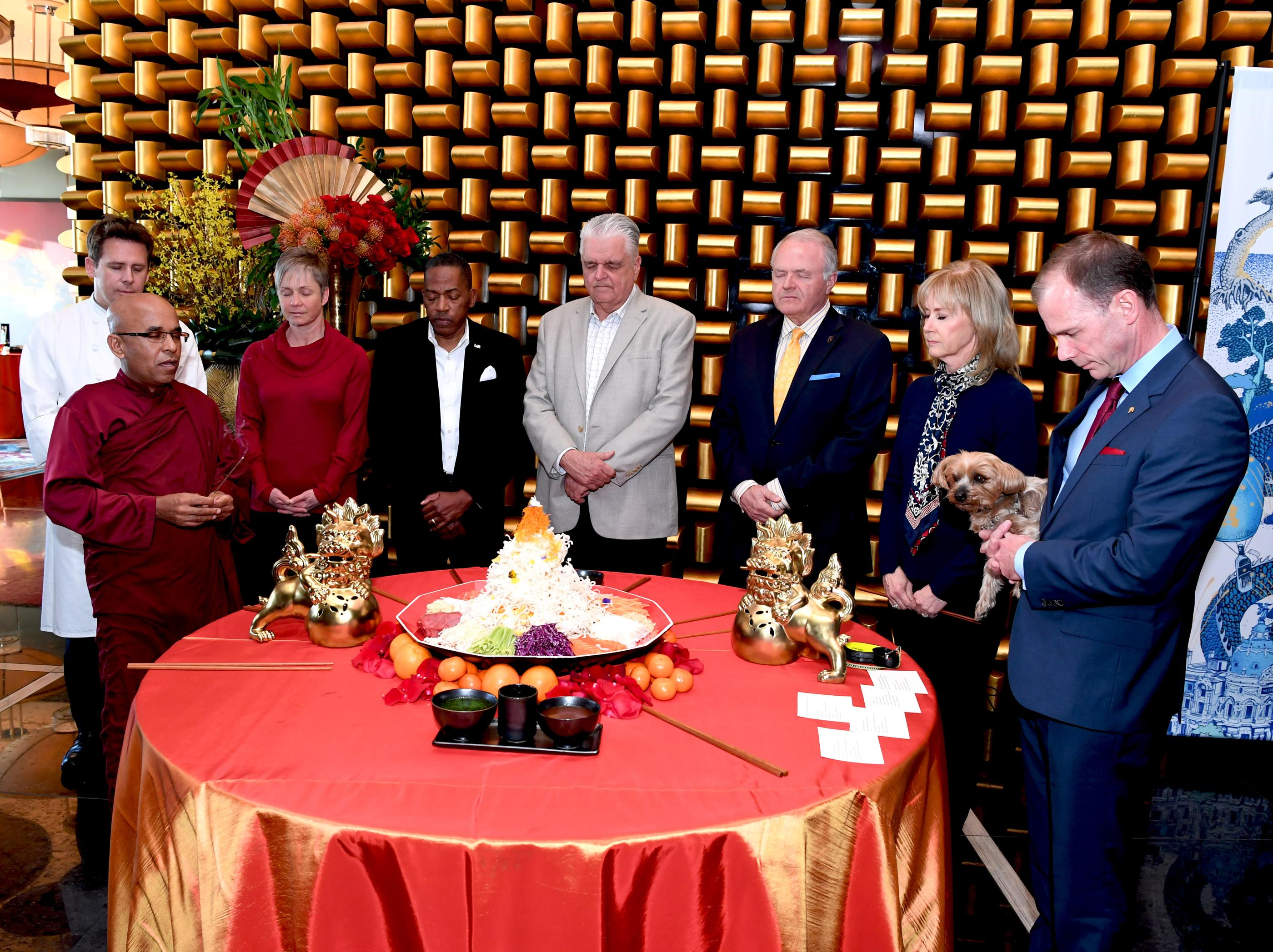 The Mandarin Oriental, Las Vegas celebrates the Chinese New Year, Year of the Dog with a special Yusheng Toss presentation. Pictured: (l-r) David Werlyu (back), Executive Chef Mandarin Oriental; Bhante Sujatha of the Blue Lotus Buddhist Temple; Ellen Charnley, wife of Donald Bowman; Lawrence Weekly, Clark County Commissioner; Steve Sisolak, Clark County Commissioner; Peter Sadowski, Executive Vice President and Chief Legal Officer for Vegas Golden Knights; Denise Decker-Sadowski, wife of Peter Sadowski; and Donald Bowman, General Manager Mandarin Oriental. Thursday, February 15, 2018. CREDIT: Glenn Pinkerton/Las Vegas News Bureau