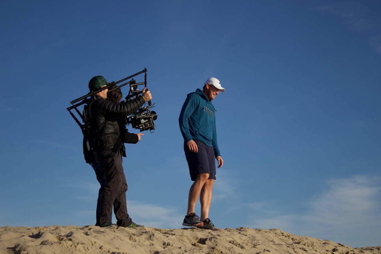 Sam stands tall at the top of a sand dune while shooting the trailer for 'My Tennis Life'
