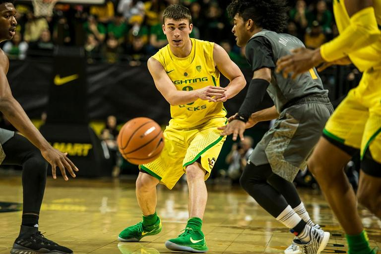 Oregon's Payton Pritchard passes the ball in their matchup with ASU, Thursday at Matthew Knight Arena. Oregon defeated ASU 75-68 to improve their season record to 18-10 (8-7 PAC-12). The Ducks face off against fourteenth ranked Arizona for their final home game of the season at Matthew Knight Arena on Saturday. (Photo by Colin Houck)