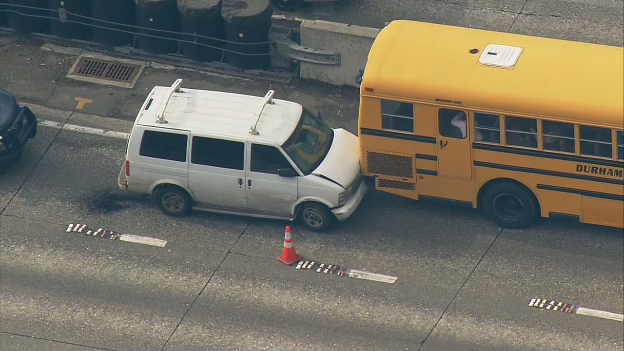 A school bus was rammed on Interstate 5 in Seattle. No children were hurt. Two people were arrested. (Photo: KOMO News)