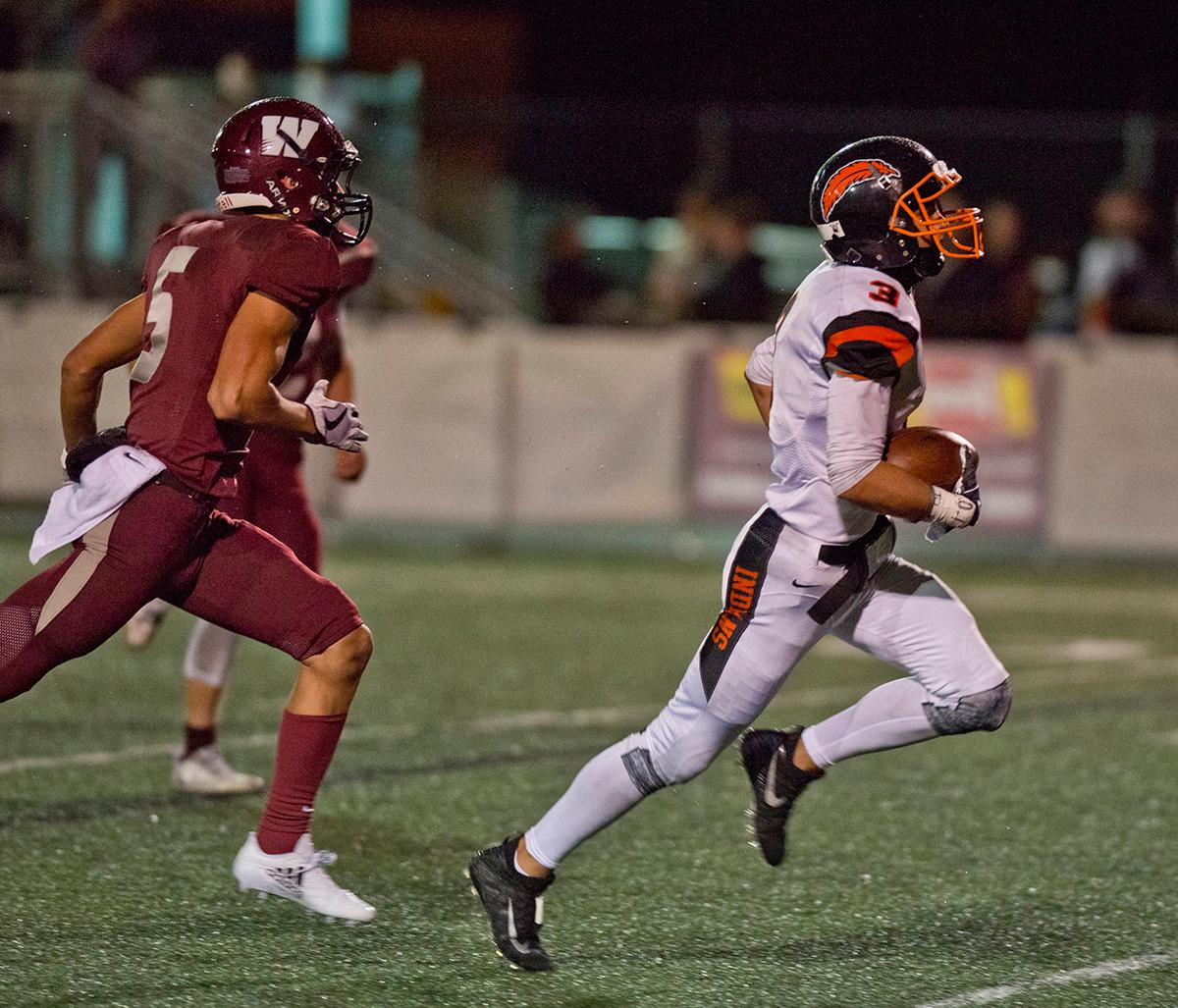 Roseburg Indians wide receiver Jondre Smith (#3) sprints into the end zone for a score against the Willametter Wolverines. Roseburg defeated Willamette 21-20 at Wolverine Stadium. Photo by Dan Morrison, Oregon News Lab