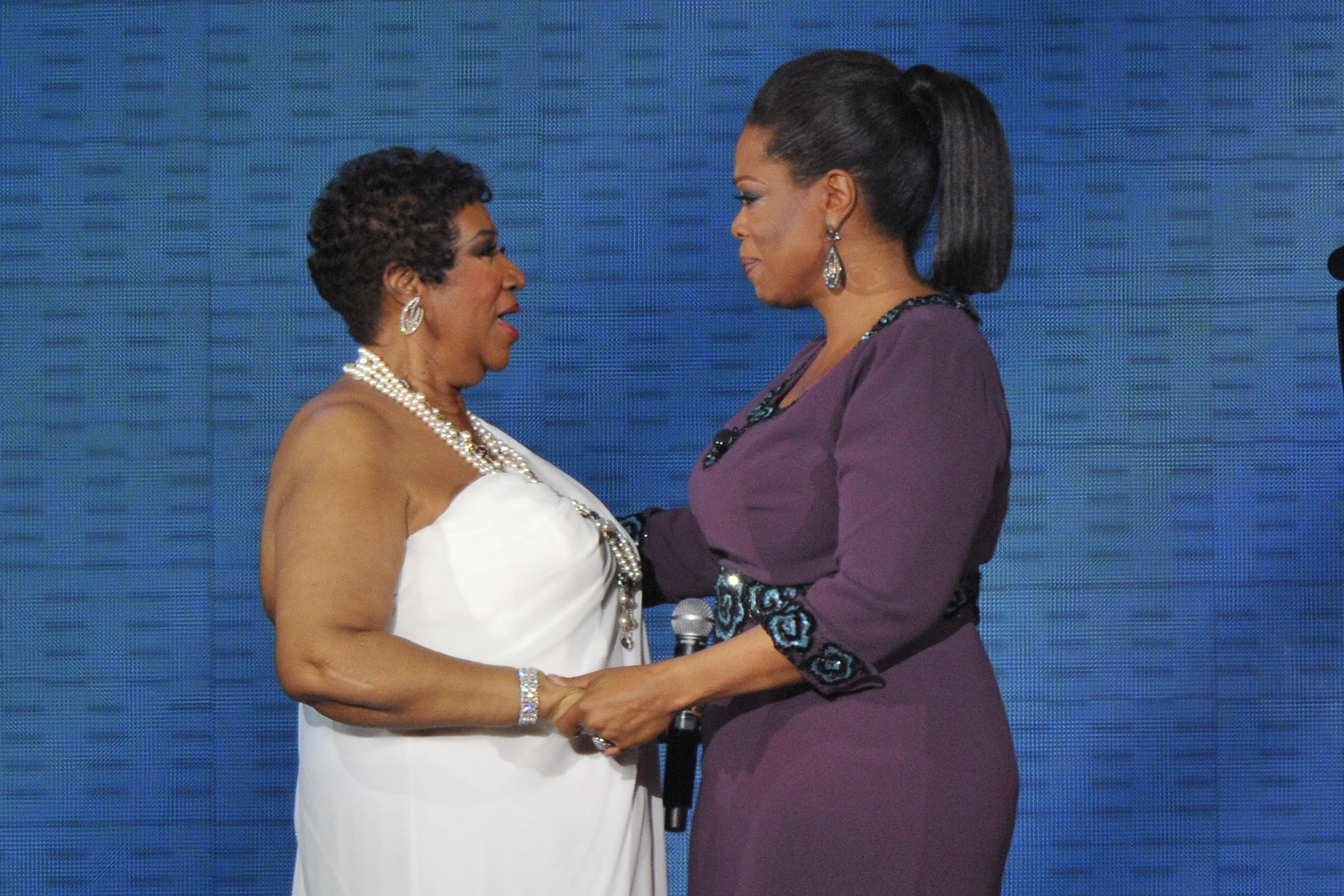 Aretha Franklin and Oprah Winfrey during 'Surprise Oprah! A Farewell Spectacular' at the United Center in Chicago, Illinois. (When: May 17 2011. Credit: Ray Garbo/WENN.com)