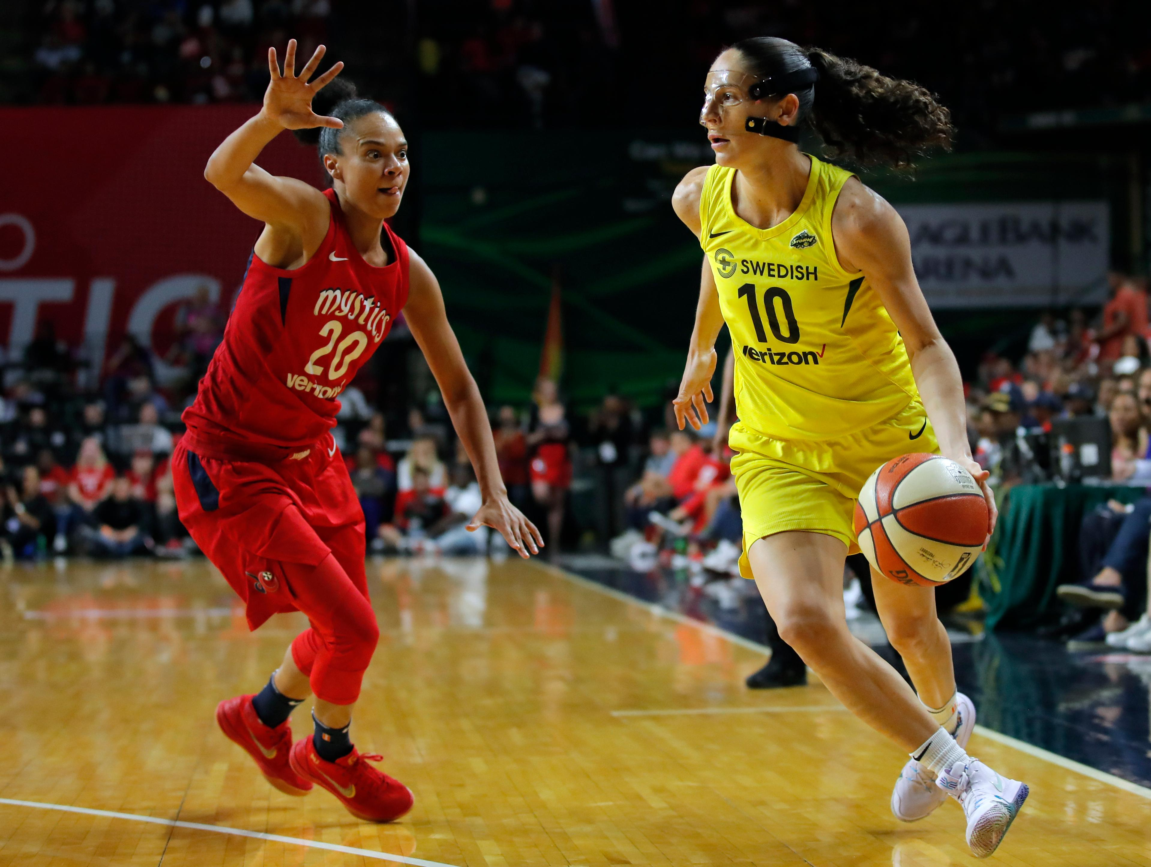 Seattle Storm guard Sue Bird (10) drives around Washington Mystics guard Kristi Toliver (20) during the second half of Game 3 of the WNBA basketball finals, Wednesday, Sept. 18 2018, in Fairfax, Va. The Seattle Storm won 98-82. (AP Photo/Carolyn Kaster)