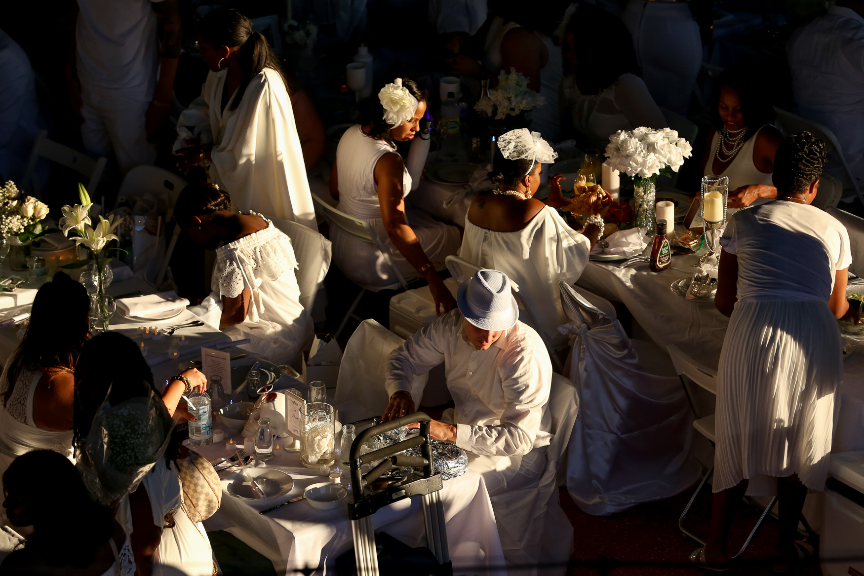 Guests at Diner en Blanc get ready for a pop-up meal at Nationals Park in August.{ }(Amanda Andrade-Rhoades/DC Refined)