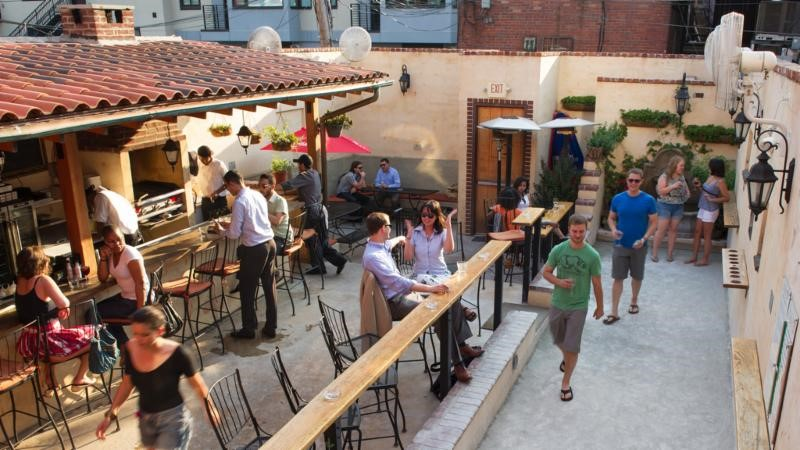 This intimate U Street spot has incredible food for both brunch and dinner, but when the temperatures rise there's no place we'd rather sip a glass of rosé. Their happy hour features 15 (!) wines for just $5, but part of the draw is their patio, which  features a bocce ball court. (Image: Courtesy Vinoteca)
