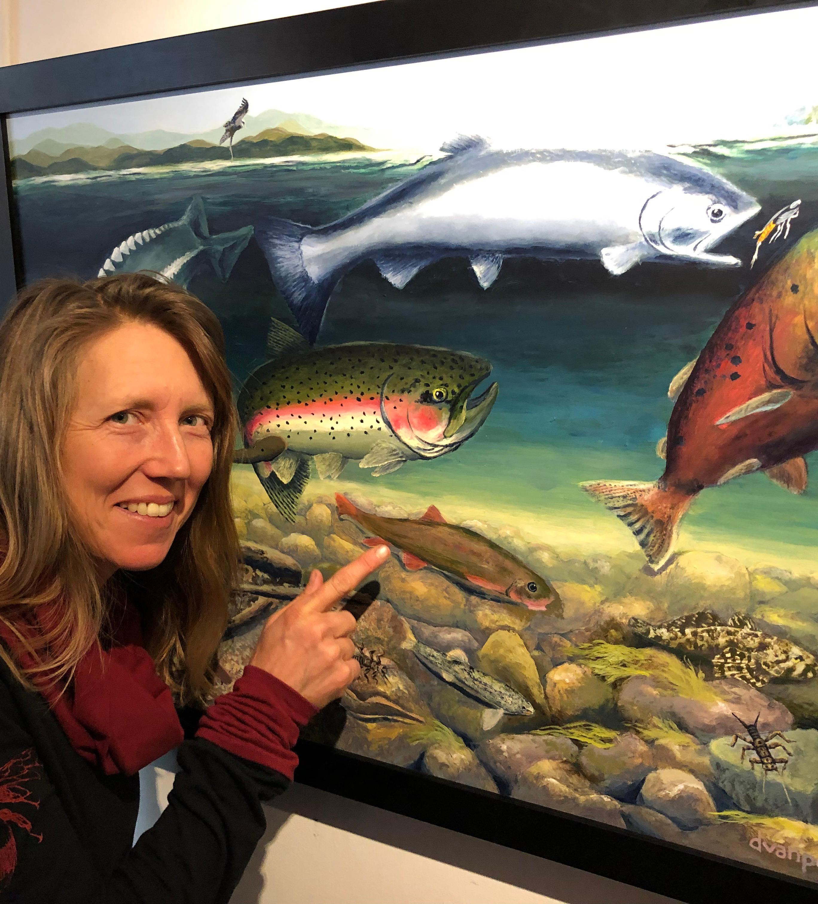 Ashland artist Deb Van Poolen poses with artwork she created used on the Klamath River Fishs poster. Photo by John Darling