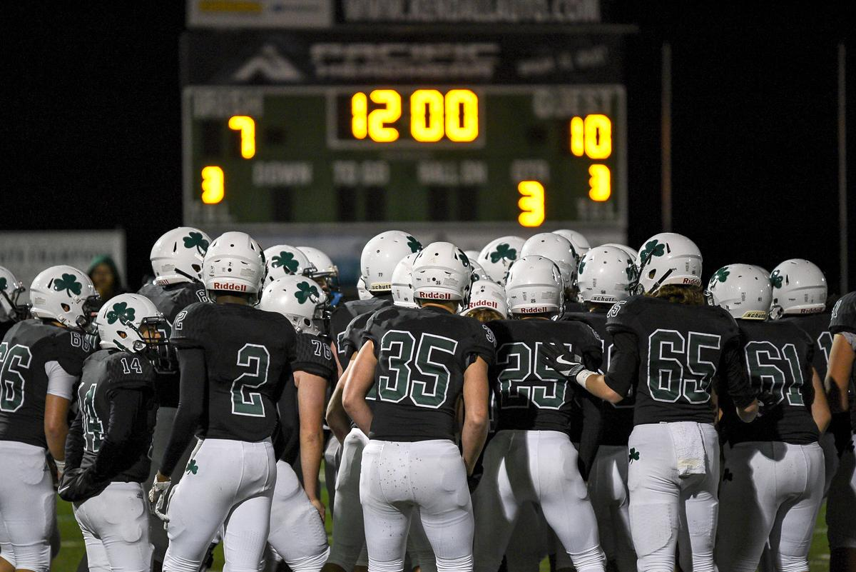Sheldon players huddle up early on in their 31-14 loss to South Medford. Photo by Jeff Dean, Oregon News Lab