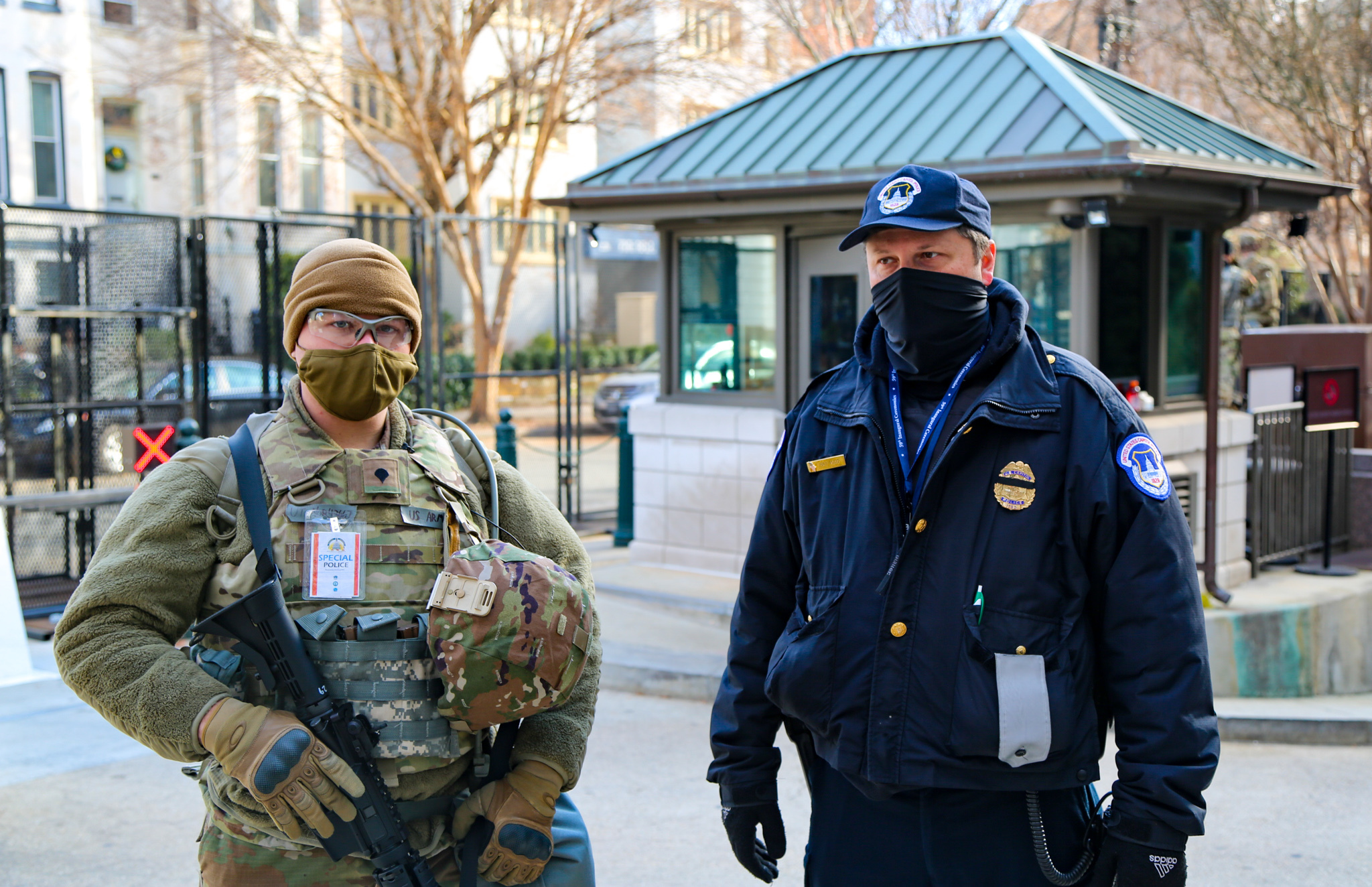 U.S. Soldier with the Utah National Guard speaks with capital police while working together in Washington D.C., Jan. 18, 2021 At least 25,000 National Guard men and women have been authorized to conduct security, communication and logistical missions in support of federal and District authorities leading up and through the 59th Presidential Inauguration. (U.S. Army National Guard photo by Spc. Christopher Hall)