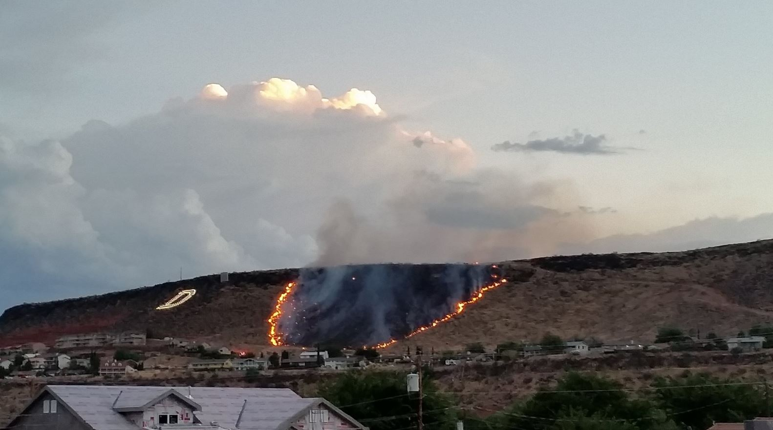 Fire burning on Black Hills in St. George. (Photo: Andrew Jensen)