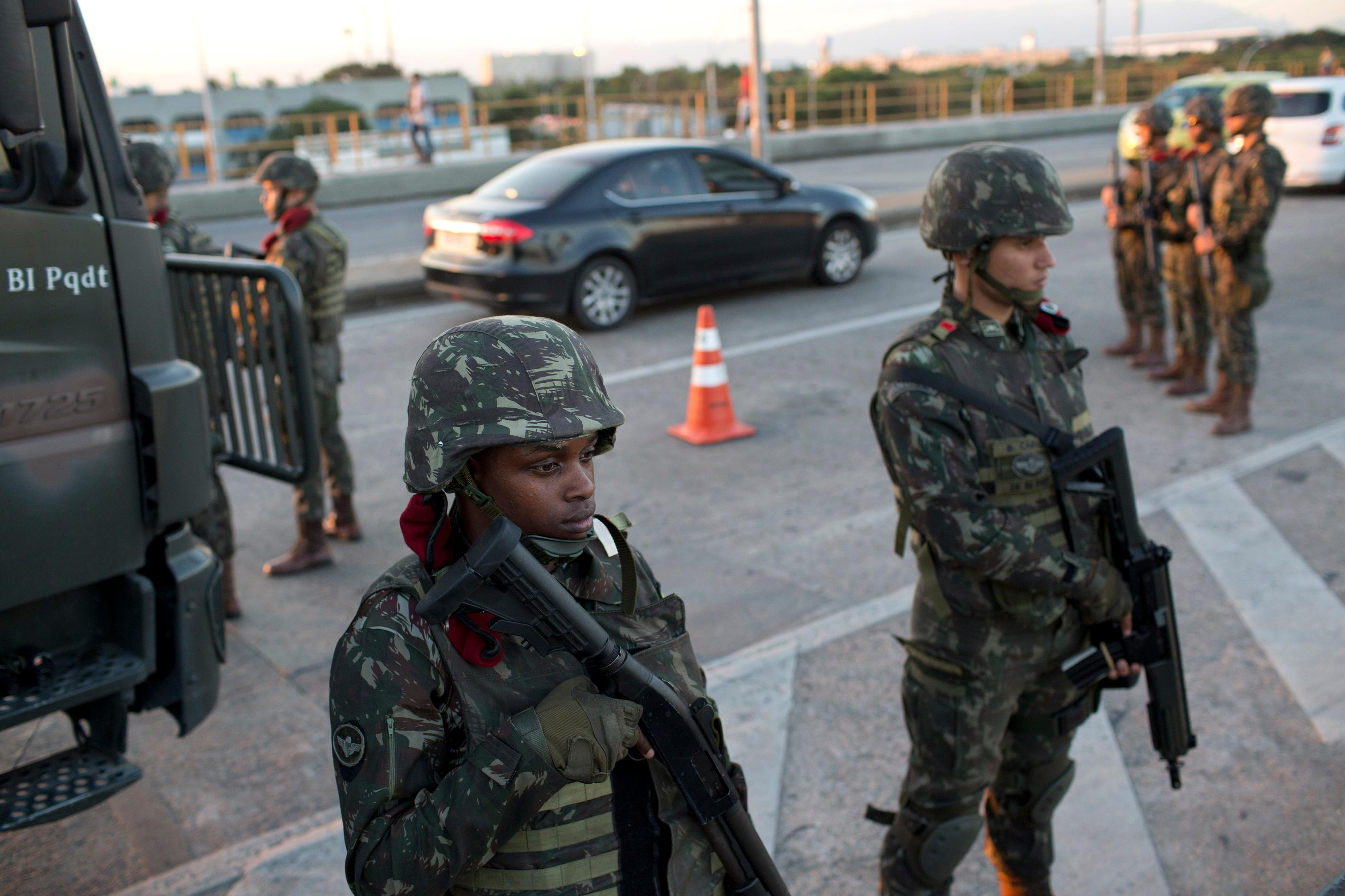 Soldiers patrol a highway near the Mare Complex slum in Rio de Janeiro, Brazil, Friday, July 28, 2017.  Thousands of Brazilian soldiers have begun patrolling in Rio de Janeiro amid a spike in violence. (AP Photo/Silvia Izquierdo)