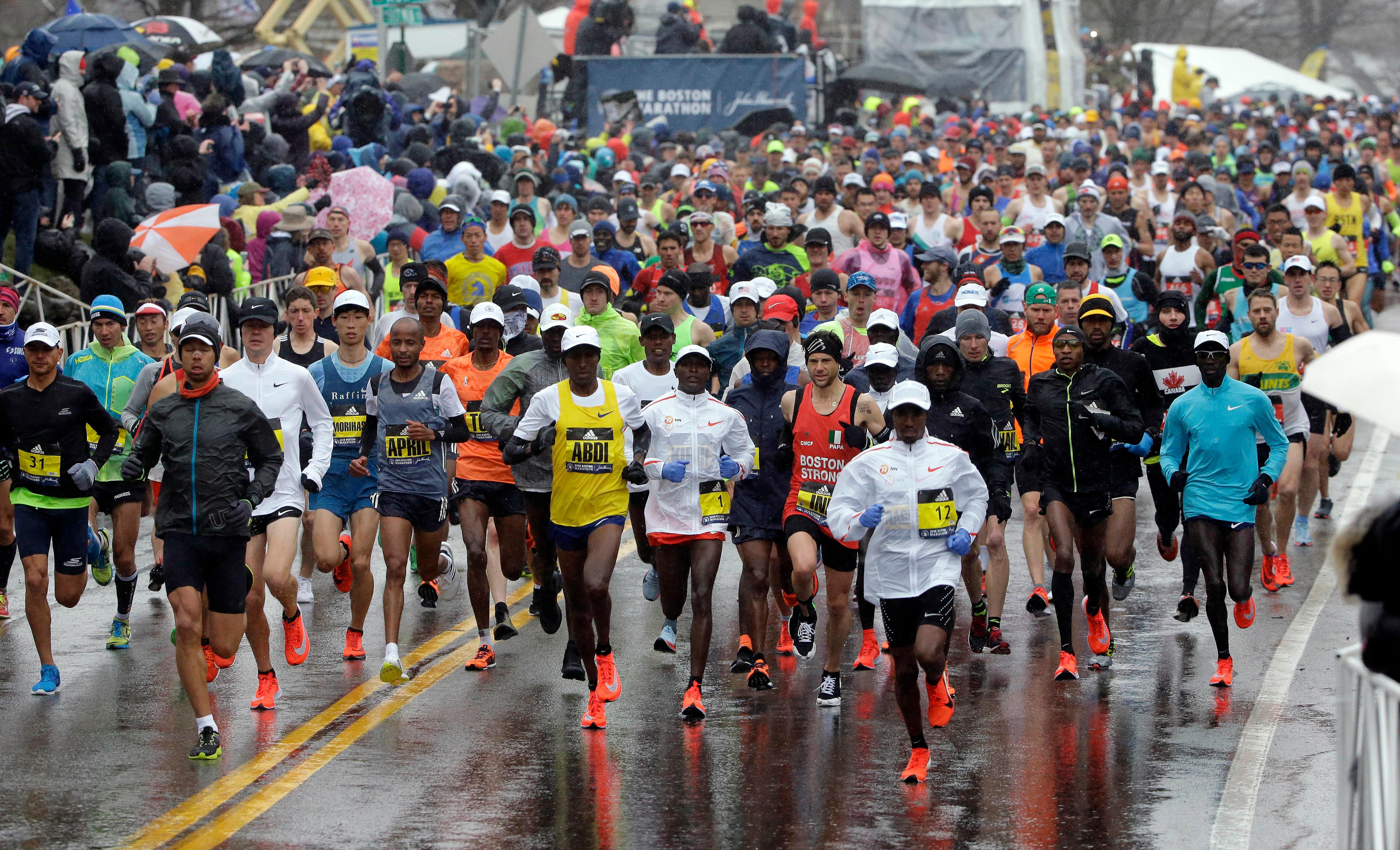 The field of men's elite runners leave the starting line in the 122nd Boston Marathon on Monday, April 16, 2018, in Hopkinton, Mass. (AP Photo/Steven Senne)