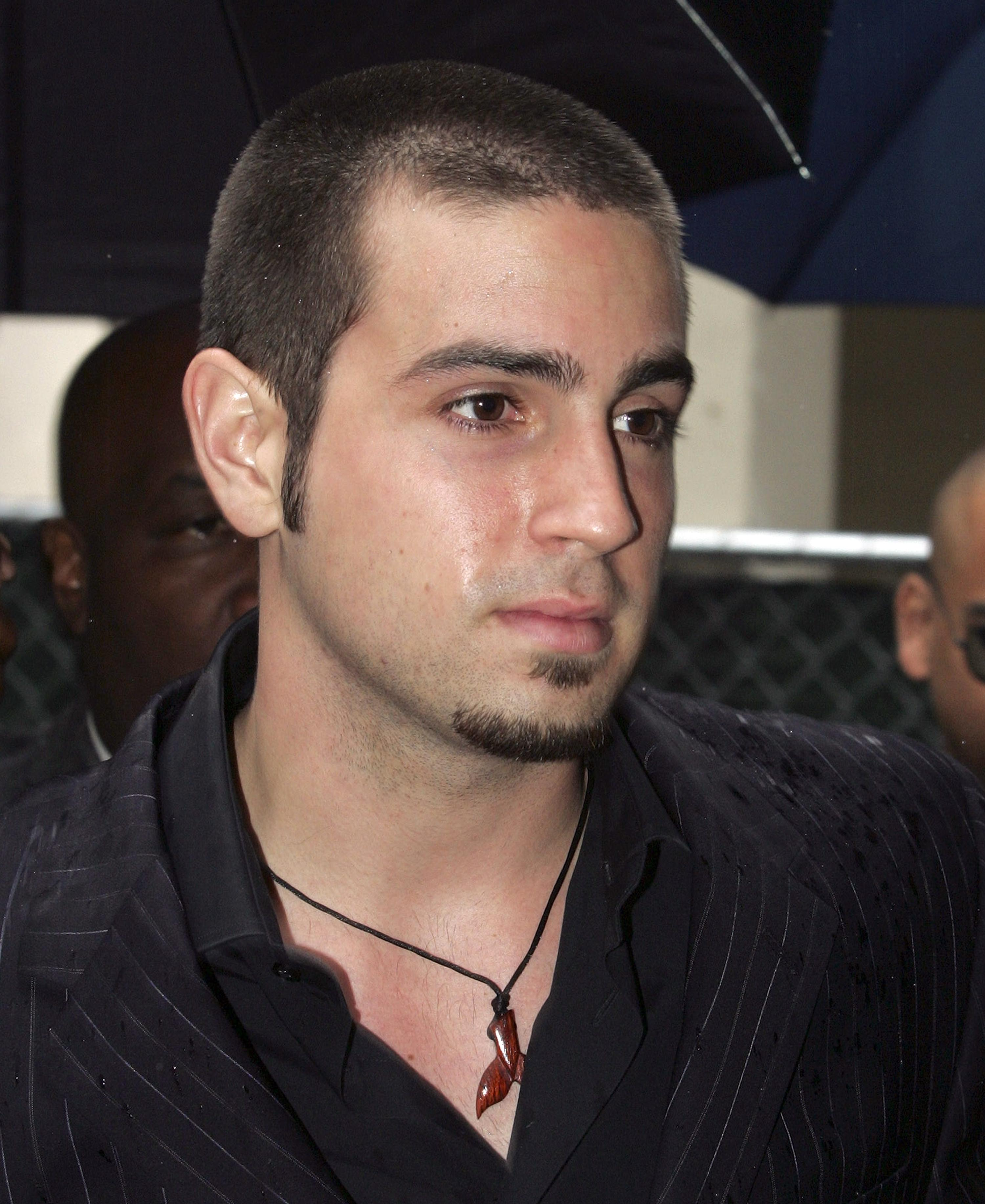 FILE - In this May 5, 2005 file photo, professional dancer Wade Robson arrives at the Michael Jackson child molestation trial in Santa Maria, Calif. A judge has dismissed the lawsuit brought by Robson, who alleged Michael Jackson molested him as a child. The summary judgment ruling Tuesday, Dec. 19, 2017, against Robson resolves one of the last remaining major claims against the late singer's holdings. (AP Photo/Carlo Allegri, Pool, File)