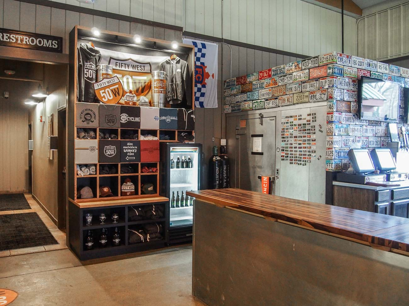 The merch displays at Fifty West Brewing Company / Image courtesy of Sediment Design // Published: 9.24.20