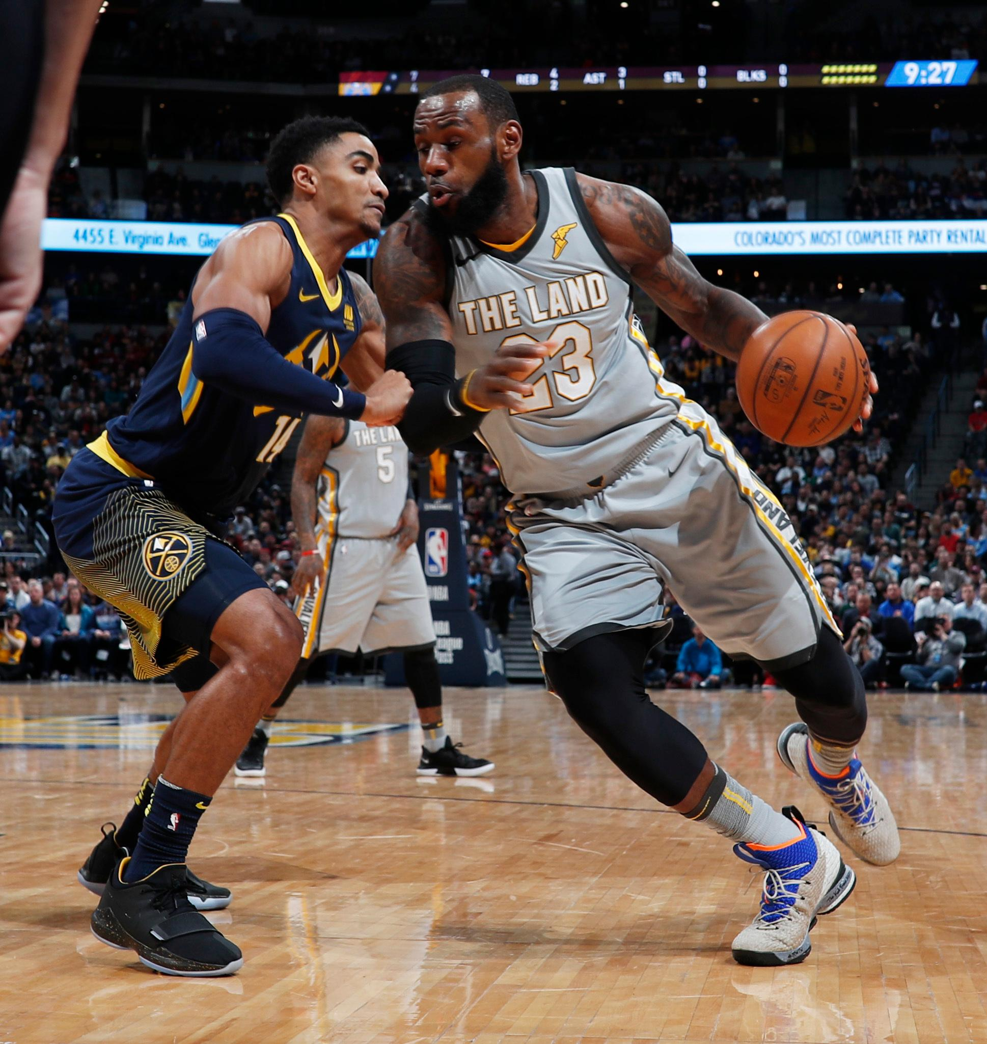Denver Nuggets guard Gary Harris, left, defends as Cleveland Cavaliers forward LeBron James drives to the basket during the first half of an NBA basketball game Wednesday, March 7, 2018, in Denver. (AP Photo/David Zalubowski)