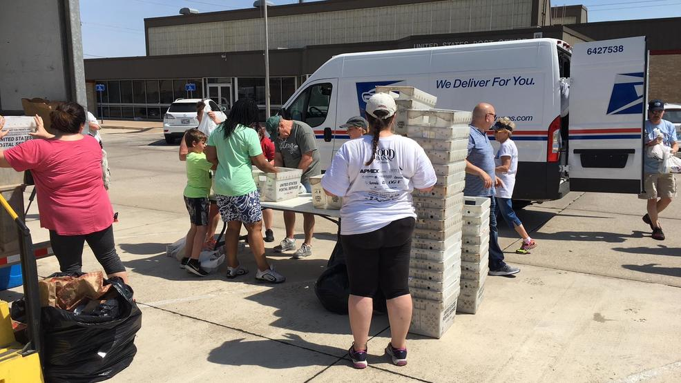 community pitches in for letter carriers food drive