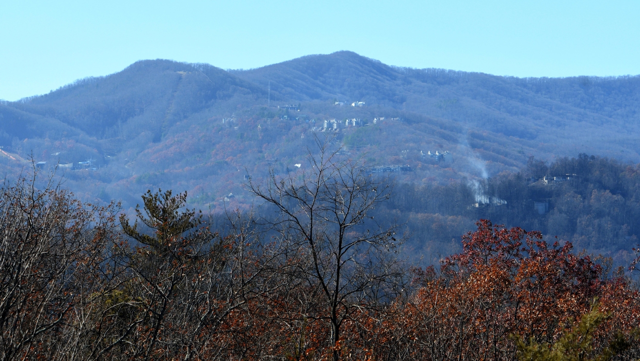 Small wildfires linger in Gatlinburg, Tenn., Thursday, Dec. 1, 2016, following Monday's devastating wildfire. (Michael Patrick/Knoxville News Sentinel via AP)