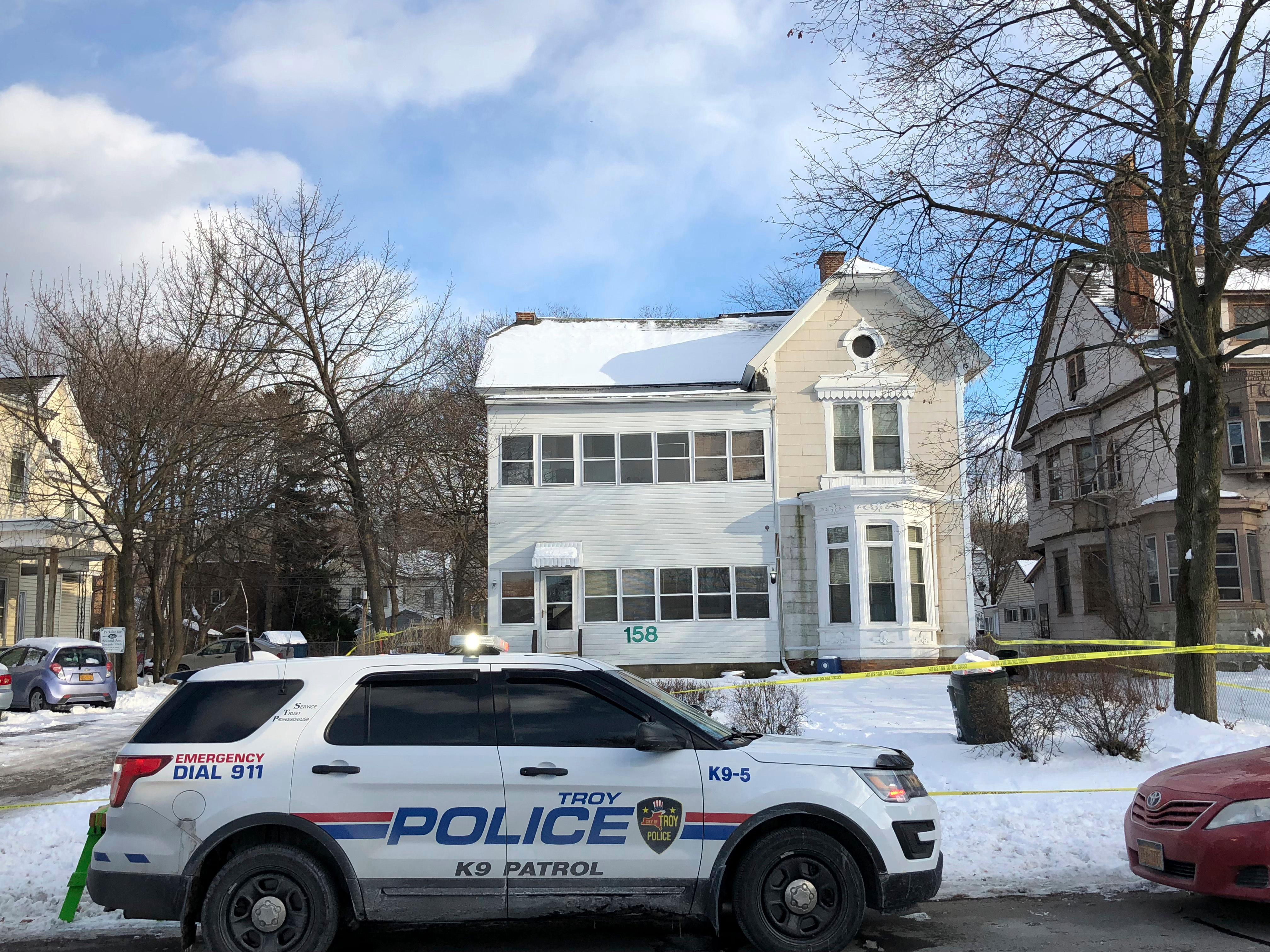 Police secure the perimeter of a home in Troy, N.Y., Tuesday, Dec. 26, 2017, after four bodies were discovered in a basement apartment. Troy police say the deaths are being treated as suspicious. (Nicholas Buonanno/The Record via AP)