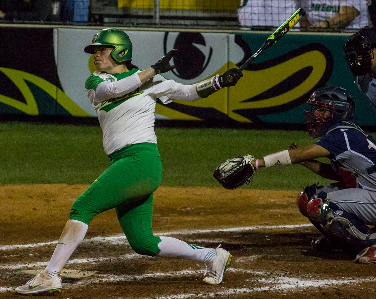 Ducks catcher Gwen Svekis (#21) singles to left field. The No. 3 Oregon Ducks defeated the University of Illinois Chicago Flames 13-0 with the run-rule on Saturday night at Jane Sanders Stadium. The Ducks scored in every inning and then scored nine runs at the bottom of the fourth. The Oregon Ducks are now 22-0 in NCAA regional games. The Oregon Ducks play Wisconsin next on Saturday, May 20 at 2pm at Jane Sanders Stadium. Photo by Aaron Alter, Oregon News Lab
