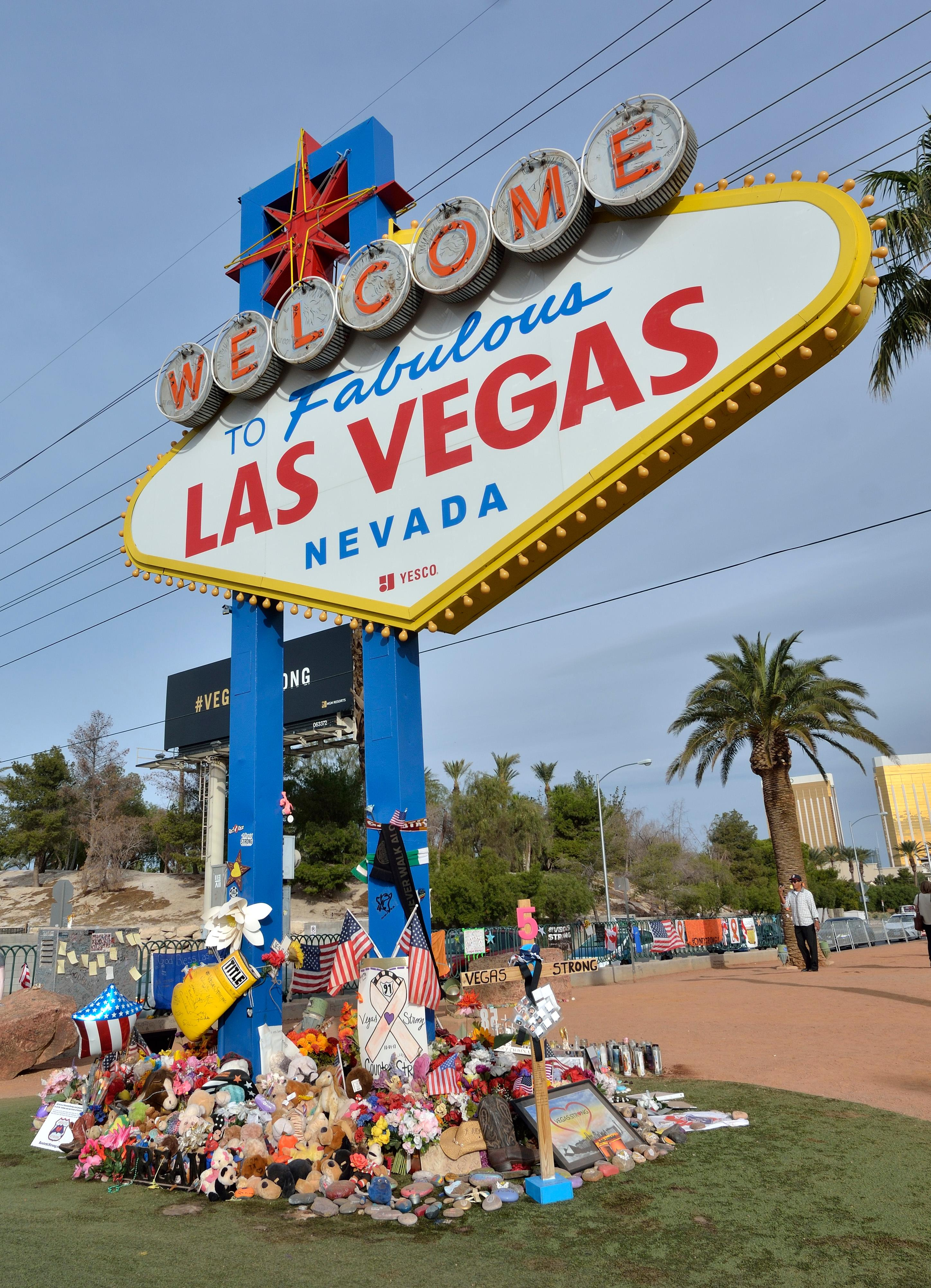 "Part of the memorial is shown during ""Greg Zanis Day"" at the Welcome to Fabulous Las Vegas sign on the Las Vegas Strip on Sunday, Nov. 12, 2017. Zanis, a carpenter from Aurora, Ill., was recognized by the Clark County Commision for creating 58 crosses memorializing those who died during the Route 91 Harvest festival shooting on Oct. 1. The crosses were later moved to the Clark County Museum for its permanent collection. [Bill Hughes/Las Vegas News Bureau]"