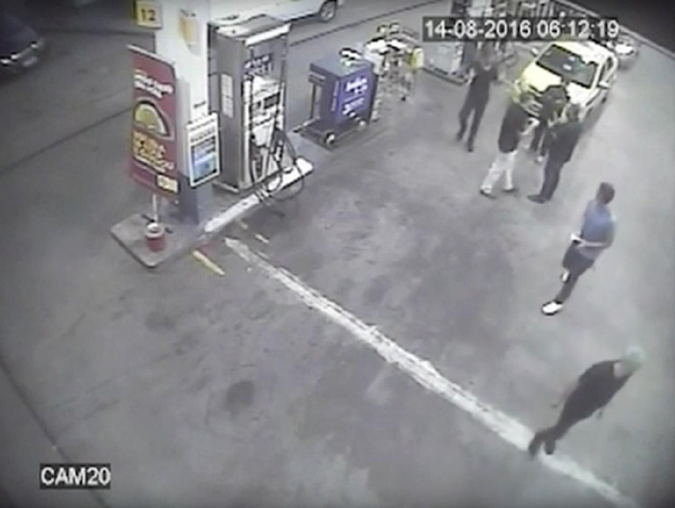 In this Sunday, Aug. 14, 2016 frame from surveillance video released by Brazil Police, swimmers from the United States Olympic team appear with Ryan Lochte, right, at a gas station during the 2016 Summer Olympics in Rio de Janeiro, Brazil. A top Brazil police official said the swimmers damaged property at the gas station. (Brazil Police via AP)