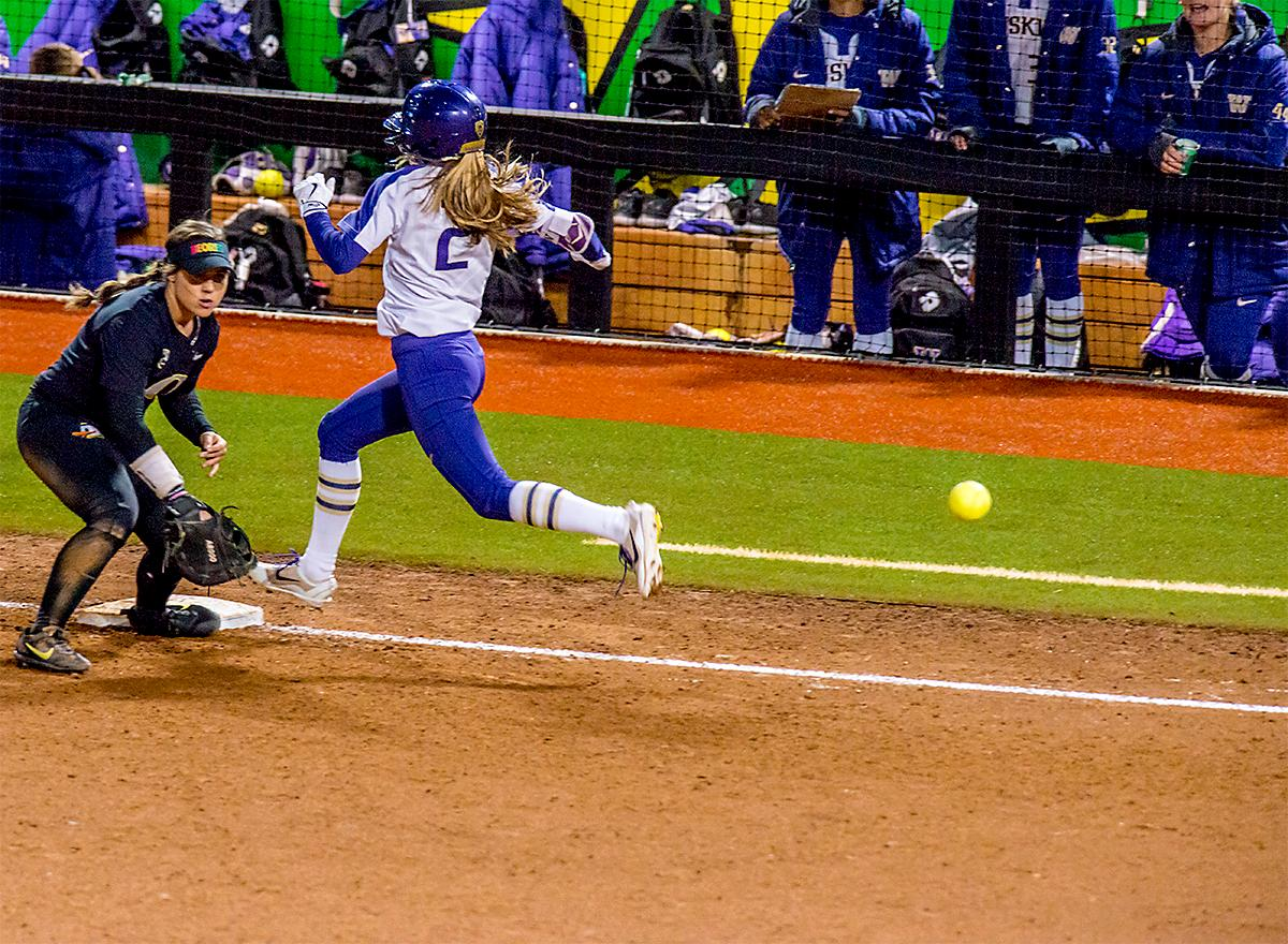 The Huskies' Trysten Melhart (#2) arrives safe at first base. In Game Two of a three-game series, the University of Oregon Ducks softball team defeated the University of Washington Huskies 4-1 Friday night in Jane Sanders Stadium. Danica Mercado (#2), Alexis Mack (#10) and Mia Camuso (#7) all scored in the win, Mack twice. The Ducks play the Huskies for the tie breaker on Saturday with the first pitch at noon. Photo by August Frank, Oregon News Lab