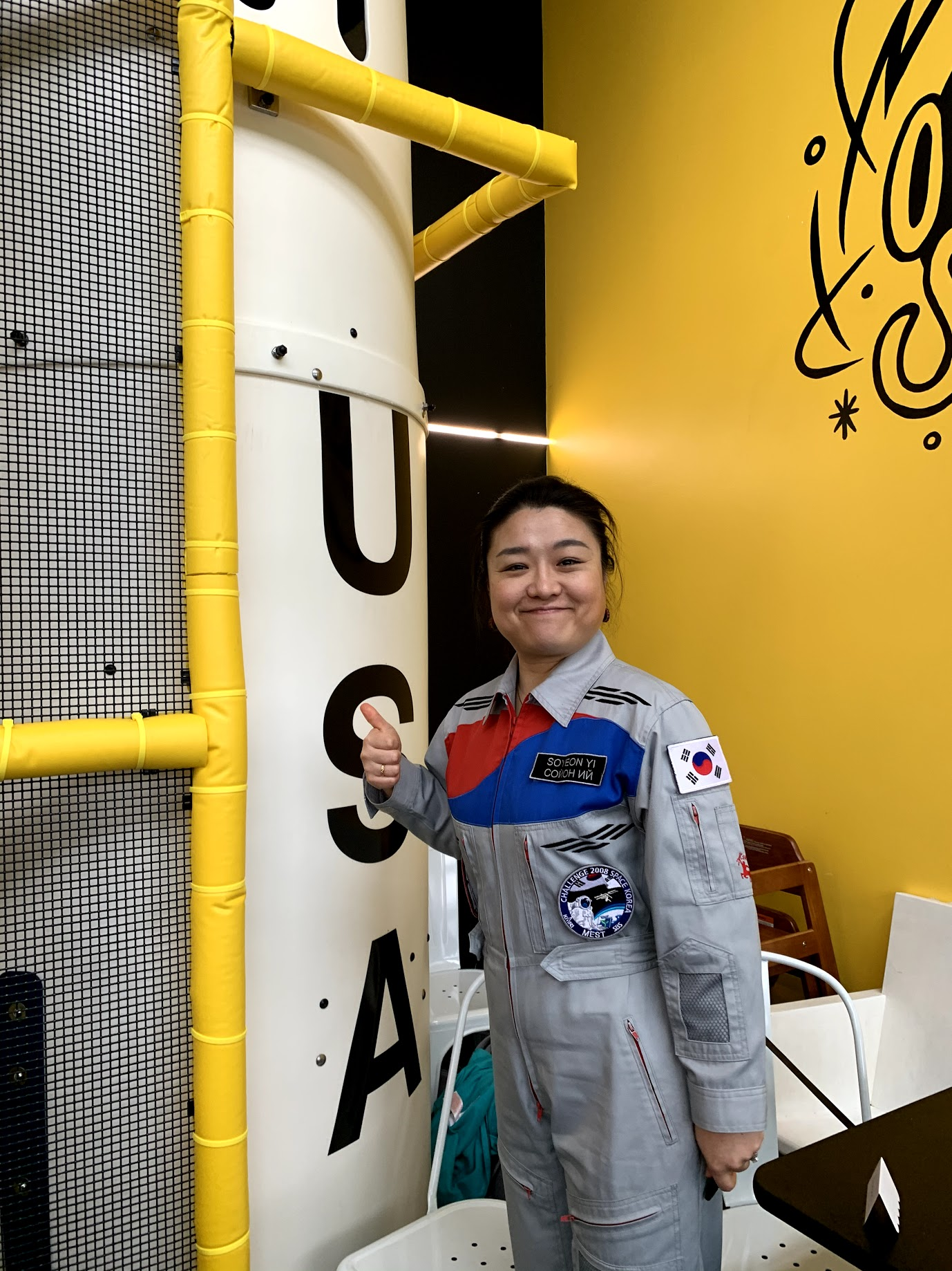 "Dr. Soyeon Yi, the first{&nbsp;}South Korean astronaut and 49th woman in space, stopped by to visit Outer Space Seattle this week, much to the kids joy! Outer Space Seattle is a space-themed indoor playspace for kids of all abilities that<a  href=""http://seattlerefined.com/lifestyle/this-new-play-space-is-out-of-this-world"" target=""_blank"" title=""http://seattlerefined.com/lifestyle/this-new-play-space-is-out-of-this-world"">{&nbsp;}just opened after one passionate mom's journey from a kickstarter</a>, to a brick and mortar play area. Dr. Yi has just visited Alki Elementary when she swung by the play space, where she had{&nbsp;}lunch, spoke to kids about what it was like to travel through space, answered questions, talked about how important it is to exercise your body, and signed the custom built rocket. (Image: Outer Space Seattle)"