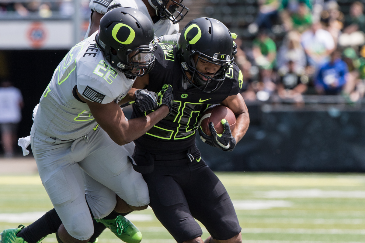 Team Free cornerback Jihree Stewart (#22) tackles Team Brave running back Tony Brooks-James (#22). The 2017 Oregon Ducks Spring Game provided fans their first look at the team under new Head Coach Willie Taggart's direction.  Team Free defeated Team Brave 34-11 on a sunny day at Autzen Stadium in Eugene, Oregon.  Photo by Austin Hicks, Oregon News Lab
