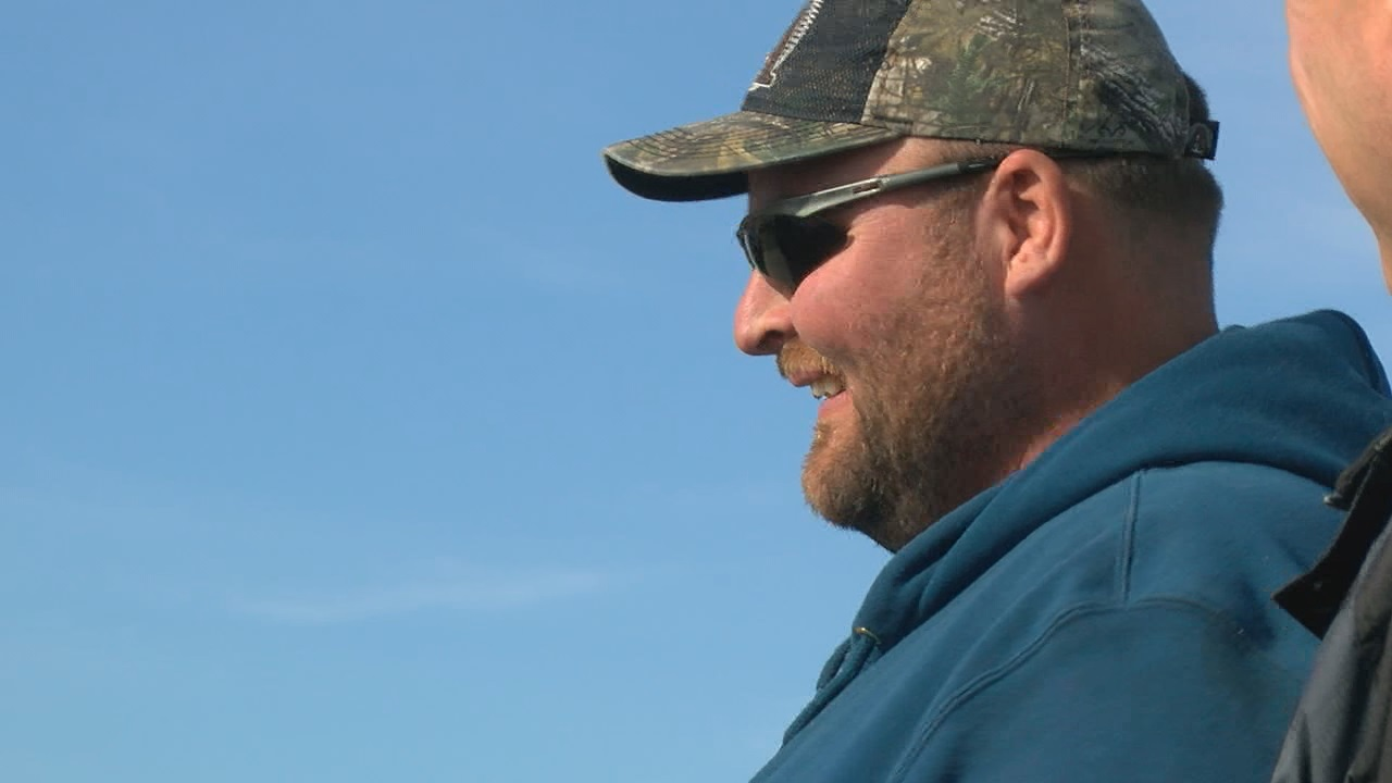 Jason Rauert takes a break during harvest (NTV News)