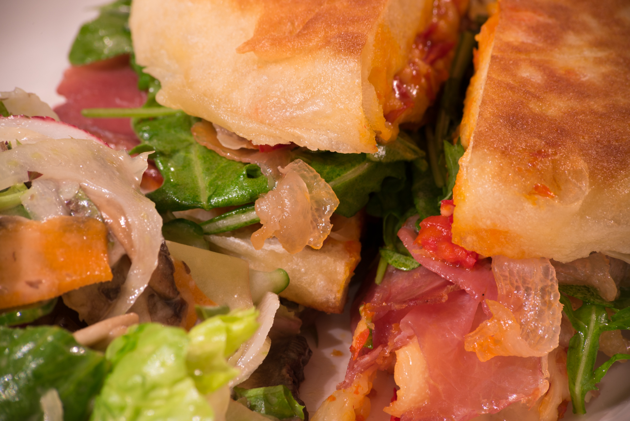 Panino with manchego, arugula, prosciutto, and pickled peppers / Image: Phil Armstrong, Cincinnati Refined // Published: 11.19.16