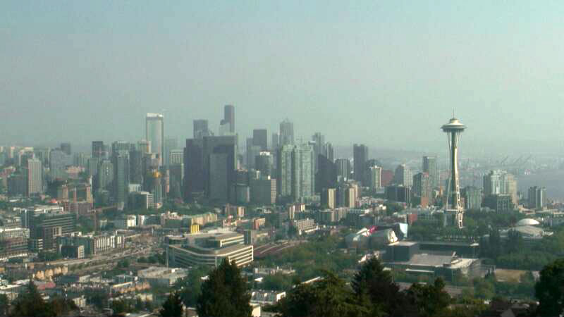 What happened to Mt. Rainier?  A milkish haze settles over Seattle on Aug. 1, 2017 as smoke from wildfires in B.C. spreads into the region.  (Photo: KOMO News)