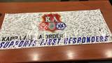 CCU fraternity presents banner of support to local law enforcement, first responders