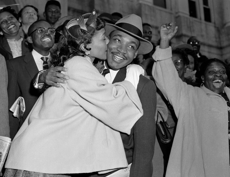 <p>FILE - In this March 22, 1956, file photo, the Rev. Martin Luther King Jr. is welcomed with a kiss by his wife, Coretta, after leaving court in Montgomery, Ala. Court records from the arrests of Rosa Parks, Martin Luther King Jr. and others at the dawn of the modern civil rights era are being preserved after being discovered in an Alabama courthouse. (AP Photo/Gene Herrick, File)</p>