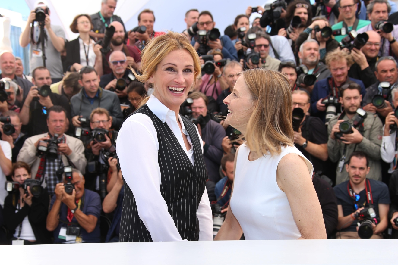 Director Jodie Foster, right, and actress Julia Roberts pose for photographers during a photo call for the film Money Monster at the 69th international film festival, Cannes, southern France, Thursday, May 12, 2016. (AP Photo/Joel Ryan)