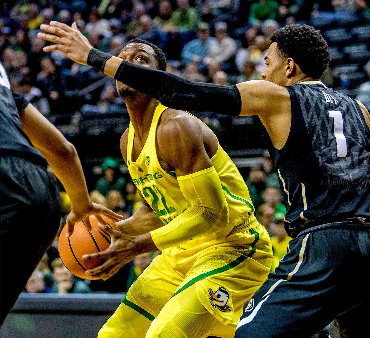 The Duck's MiKyle McIntosh (#22) looks for a path to the basket. The Oregon Ducks defeated the Colorado Buffaloes 77-62 at Matthew Knight Arena on Sunday. Troy Brown had a season-high score of 21 points, Elijah Brown added 17, while Kenny Wooten and Payton Pritchard added 13 and 12 respectively. Oregon is now 1-1 in conference play. The Ducks next face off against the Oregon State Beavers in Corvallis on Friday, January 5th. Photo by August Frank, Oregon News Lab