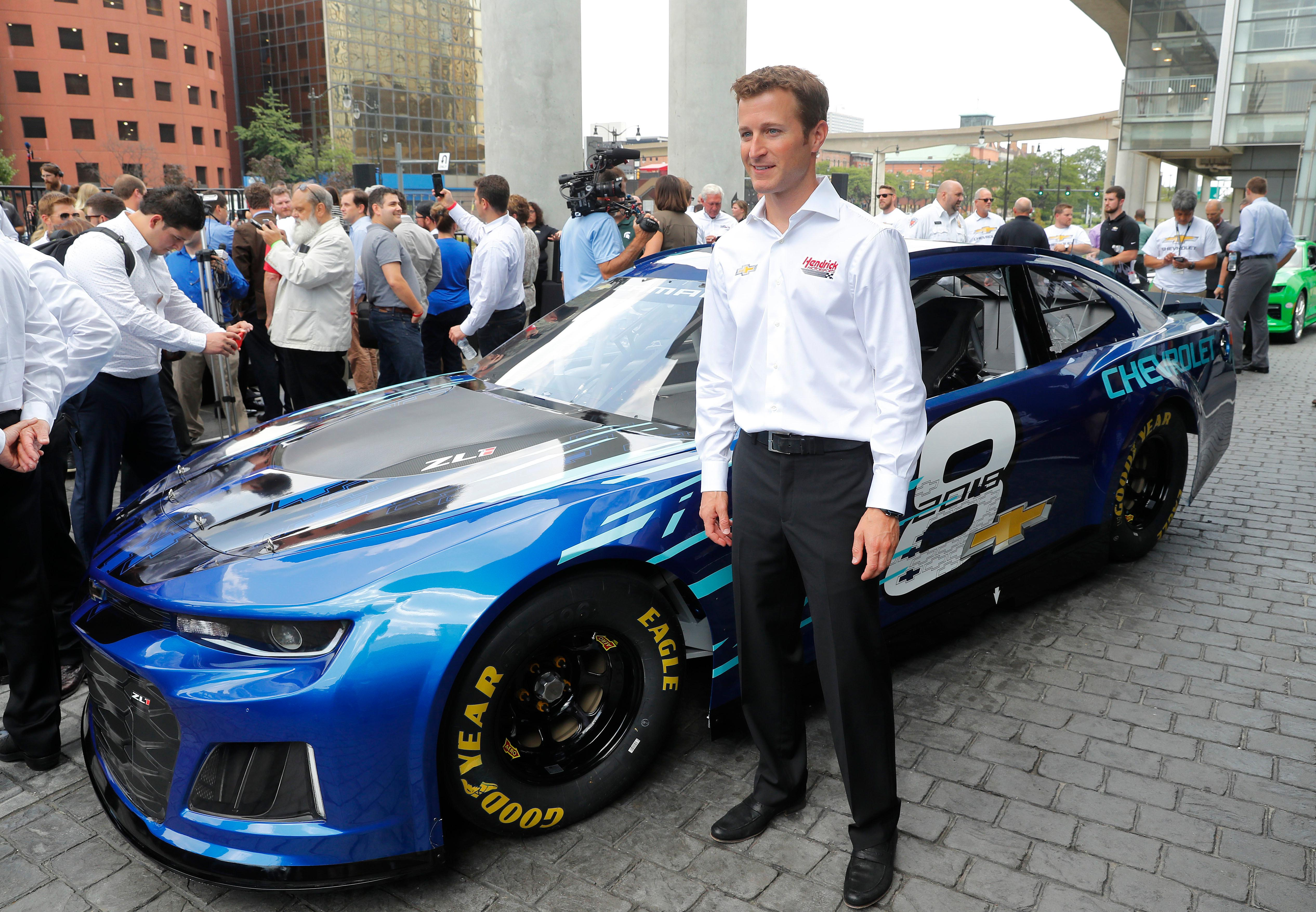 2018 chevrolet nascar cup car.  nascar kasey kahne poses with the 2018 chevrolet camaro zl1 as new race car  was introduced for chevrolet nascar cup