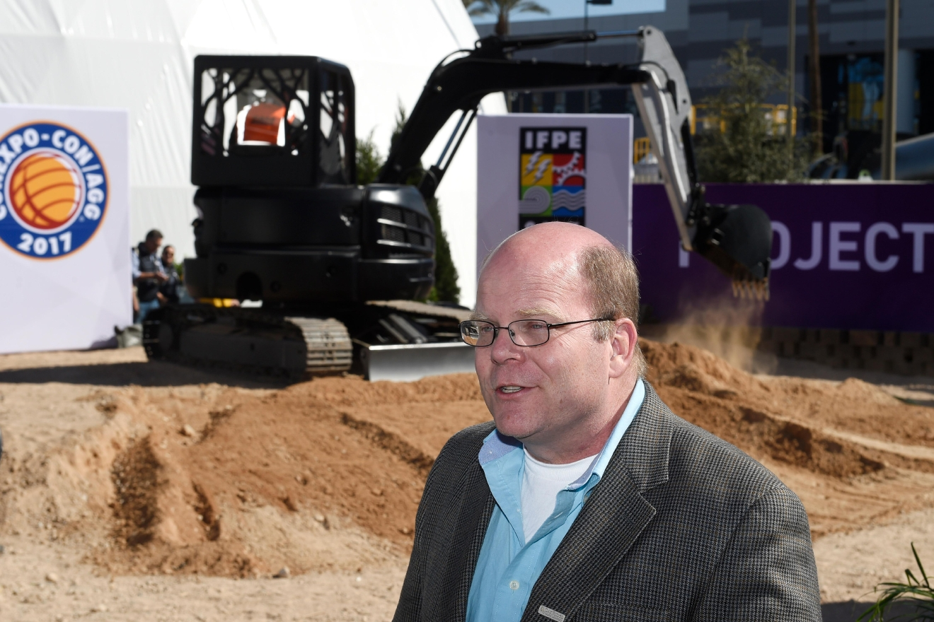 Lonnie Love, group leader for manufacturing systems research at the Oak Ridge National Lab, gives an interview while the first-ever 3D printed excavator is demonstrated behind him during the first day of the 2017 CONEXPO-CON/AGG convention Tuesday, March 7, 2017, at the Las Vegas Convention Center. [Sam Morris/Las Vegas News Bureau]