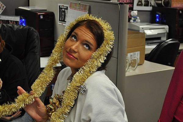 Producer Candace White getting ready for tacky sweater contest