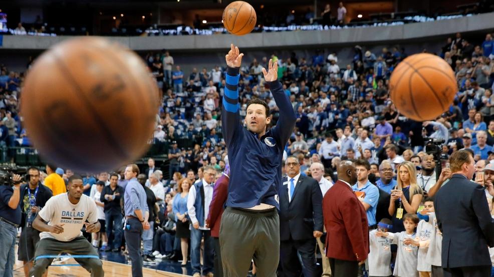 5420dd10d24 Former Dallas Cowboys quarterback Tony Romo takes a shot during warm ups  before an NBA basketball game between the Denver Nuggets and Dallas  Mavericks in ...