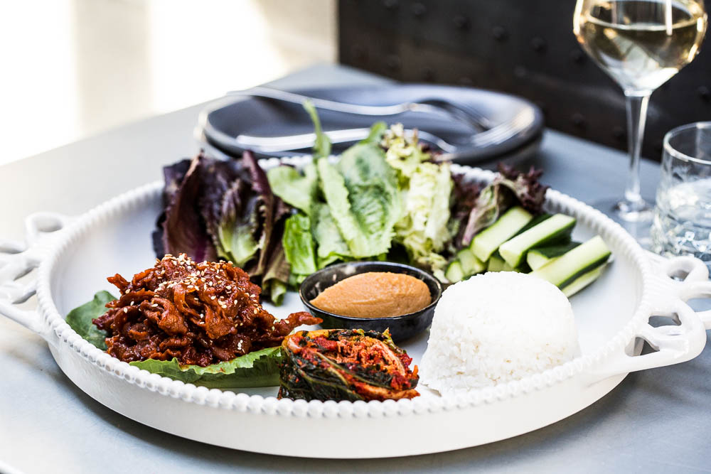 Lettuce wrap platter: Spicy or soy marinated pork, bean paste, kimchi, rice