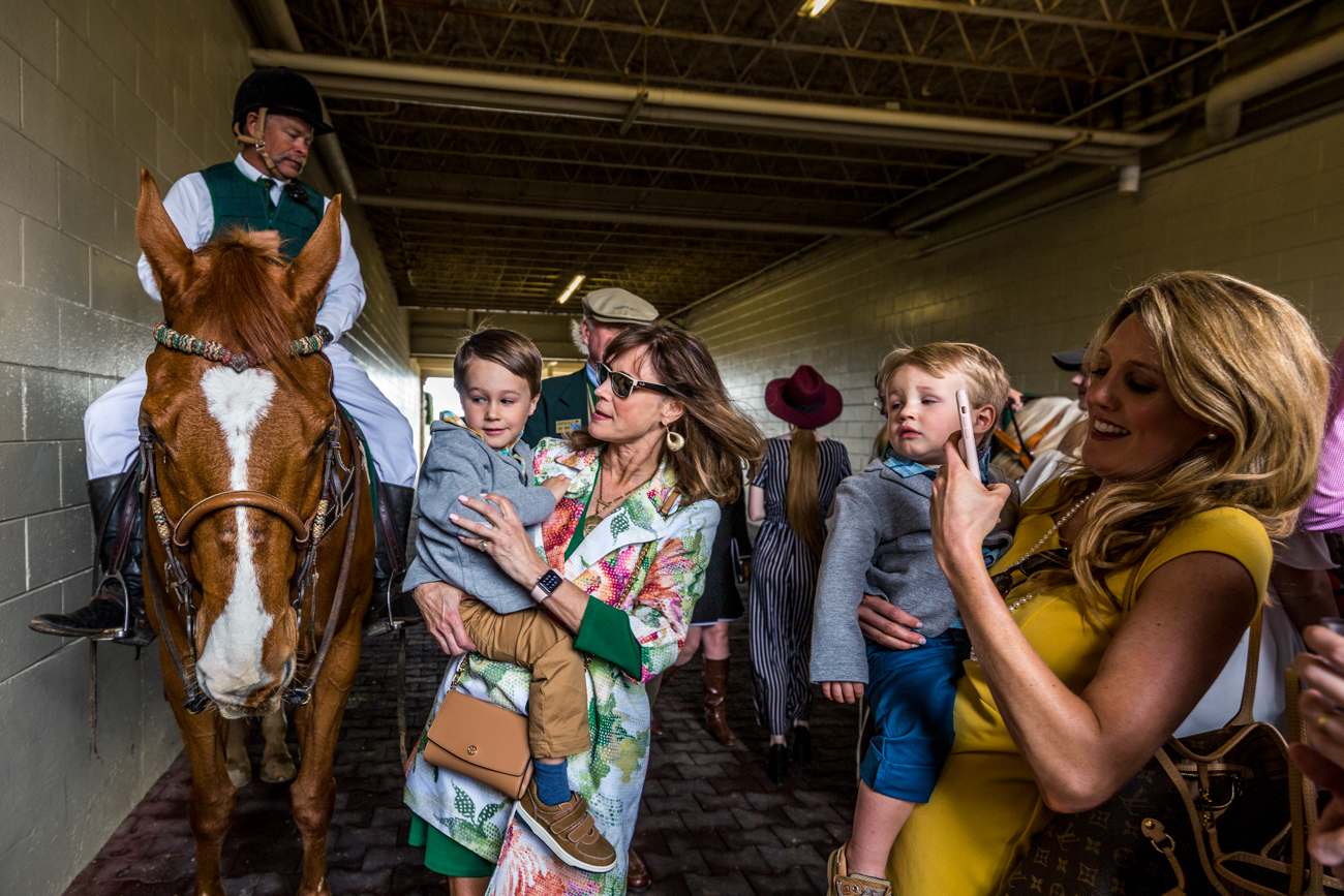 A family meets one of the racehorses and jockeys in the paddock area. / Image courtesy of Catherine Viox // Published:{ }4.12.19