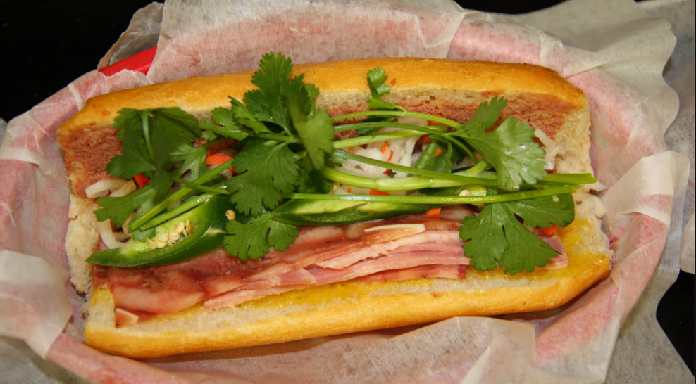 There are plenty of spots serving Banh Mi sandwiches, but Nhu Lan is especially popular. Opt for the signature sandwich, which comes with a hefty portion of pate, ham, cilantro and pickled radish. (Image: Courtesy Nhu Lan)
