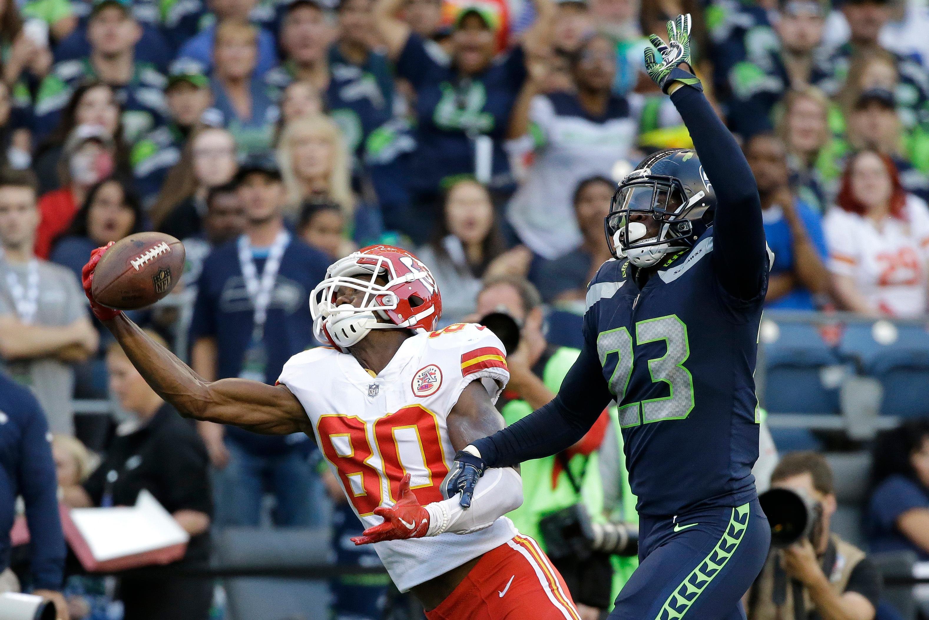 Kansas City Chiefs wide receiver Jehu Chesson (80) is unable to catch a pass as Seattle Seahawks defensive back Neiko Thorpe (23) grabs his arm during the second half of an NFL football preseason game, Friday, Aug. 25, 2017, in Seattle. Thorpe was called for pass interference. (AP Photo/Elaine Thompson)