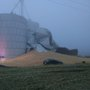Grain silo collapses; spills tons of grain on road causing crashes