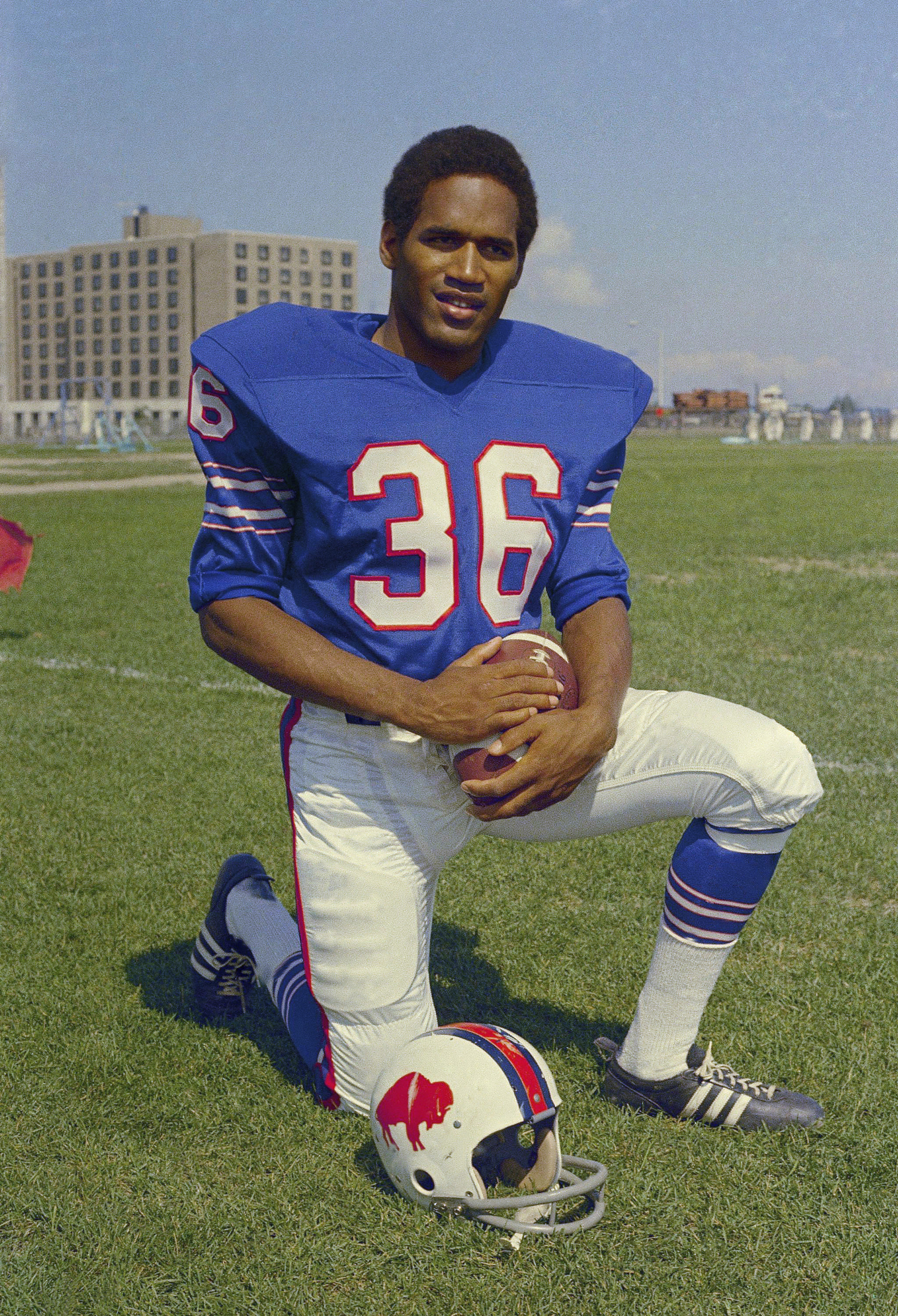 FILE - In this 1969 file photo, shows O.J. Simpson, football player for the Buffalo Bills. 1969: The first pick in the pro draft, Simpson goes to the Buffalo Bills and spends the next nine seasons with the team. O.J. Simpson's release from a Nevada prison turns another page in one of the most dramatic falls from grace in American pop culture history. A beloved college and pro football hero in the 1960s and '70s, Simpson went on to become a movie star, sports commentator and TV pitchman in the years before the 1994 killings of his ex-wife and her friend in Los Angeles. A Nevada prison official said early Sunday, Oct. 1, 2017, O.J. Simpson, the former football legend and Hollywood star, has been released from a Nevada prison in Lovelock after serving nine years for armed robbery. (AP Photo/File)