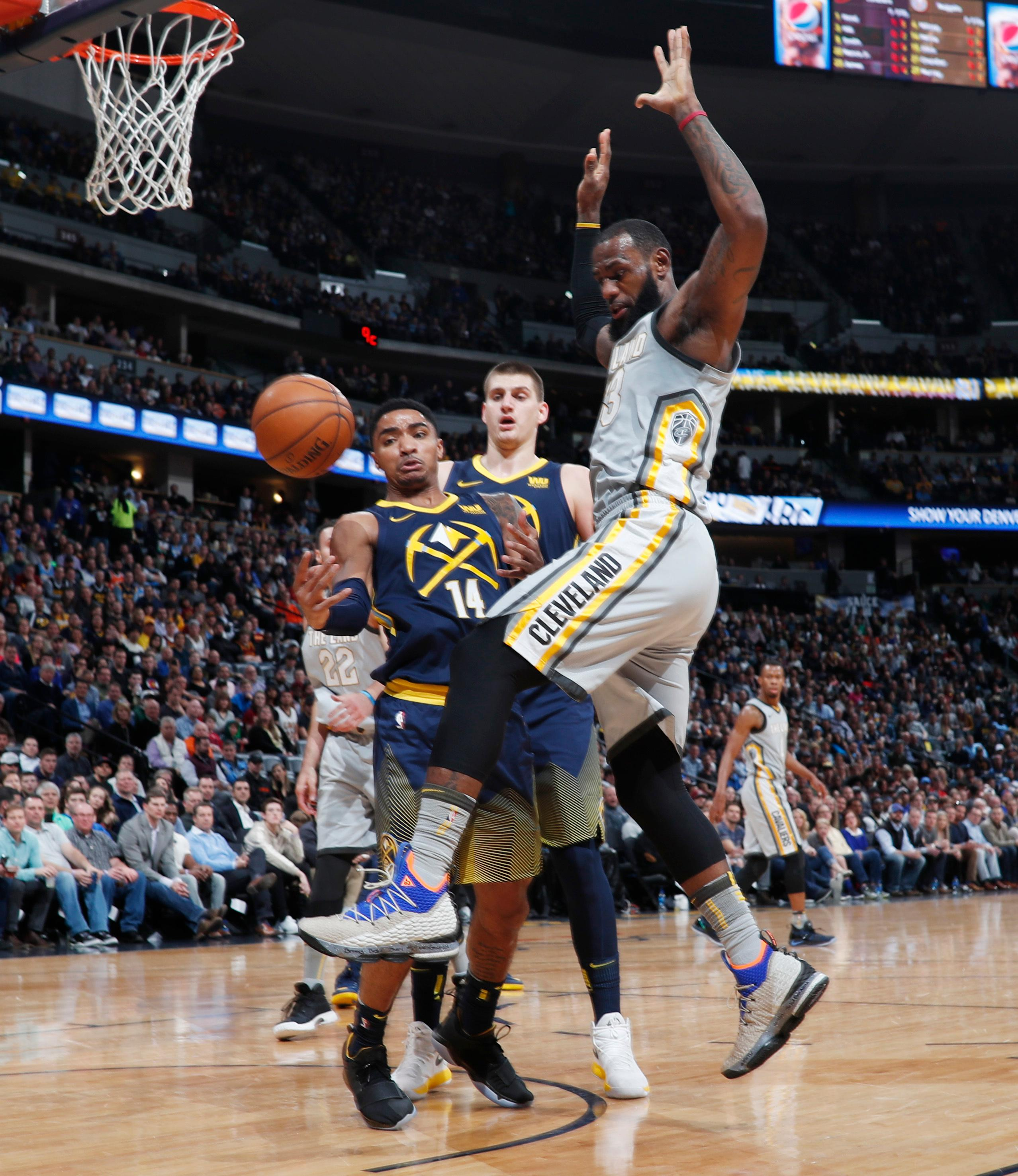 Denver Nuggets guard Gary Harris, left, knocks the ball out of the hands of Cleveland Cavaliers forward LeBron James during the first half of an NBA basketball game Wednesday, March 7, 2018, in Denver. (AP Photo/David Zalubowski)