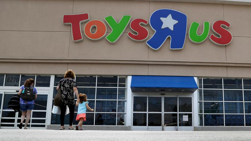 FILE   In This Sept. 19, 2017, File Photo, Shoppers Walk Into A Toys R Us  Store, In San Antonio. Toys R Us Says It Will Be Closing Some U.S. Stores  And ...